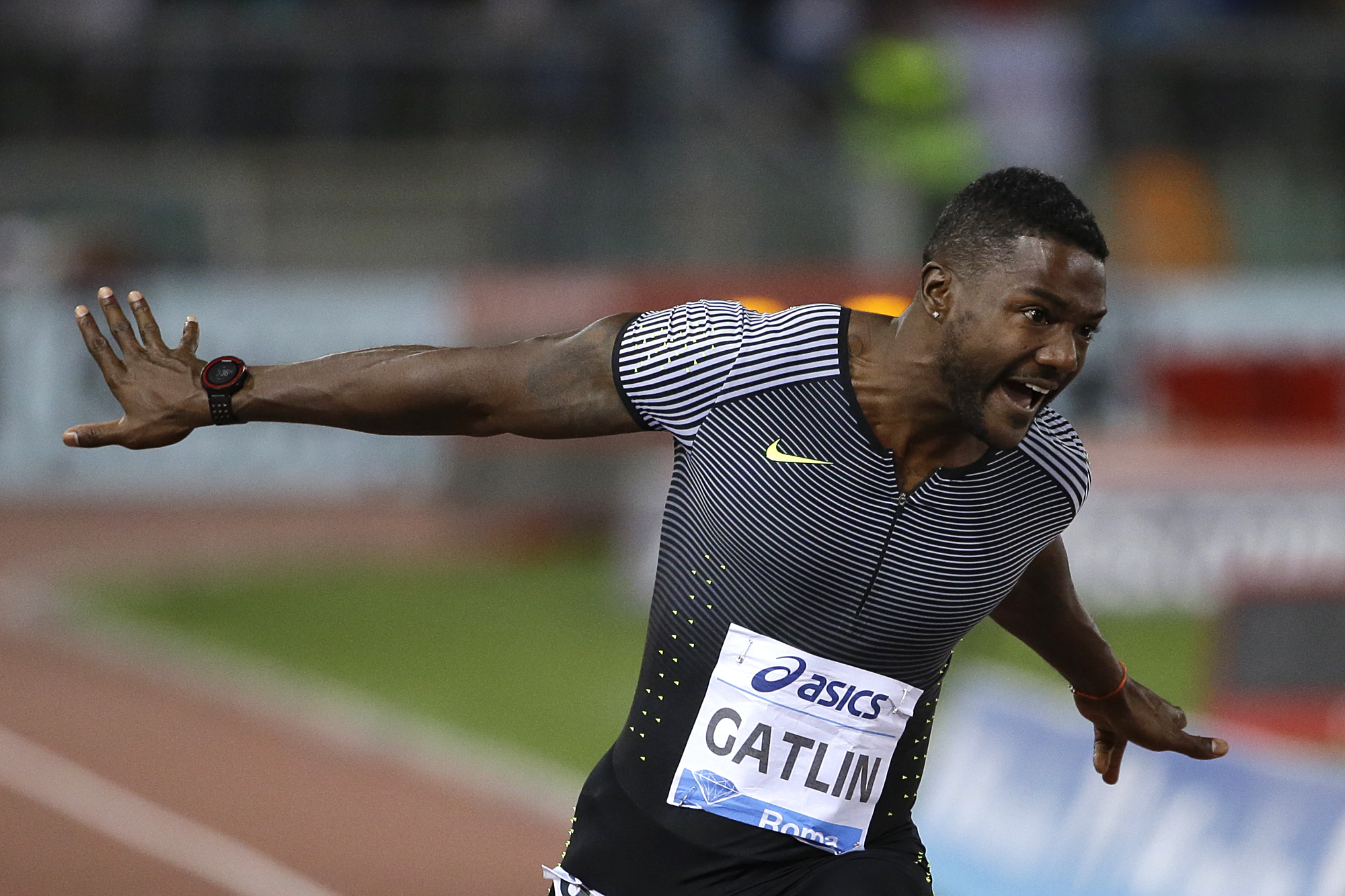 Justin Gatlin, of the United States, celebrates after winning the men's 100m event at the Golden Gala IAAF athletic meeting, in Rome's Olympic stadium, Thursday, June 2, 2016. (AP Photo/Gregorio Borgia)