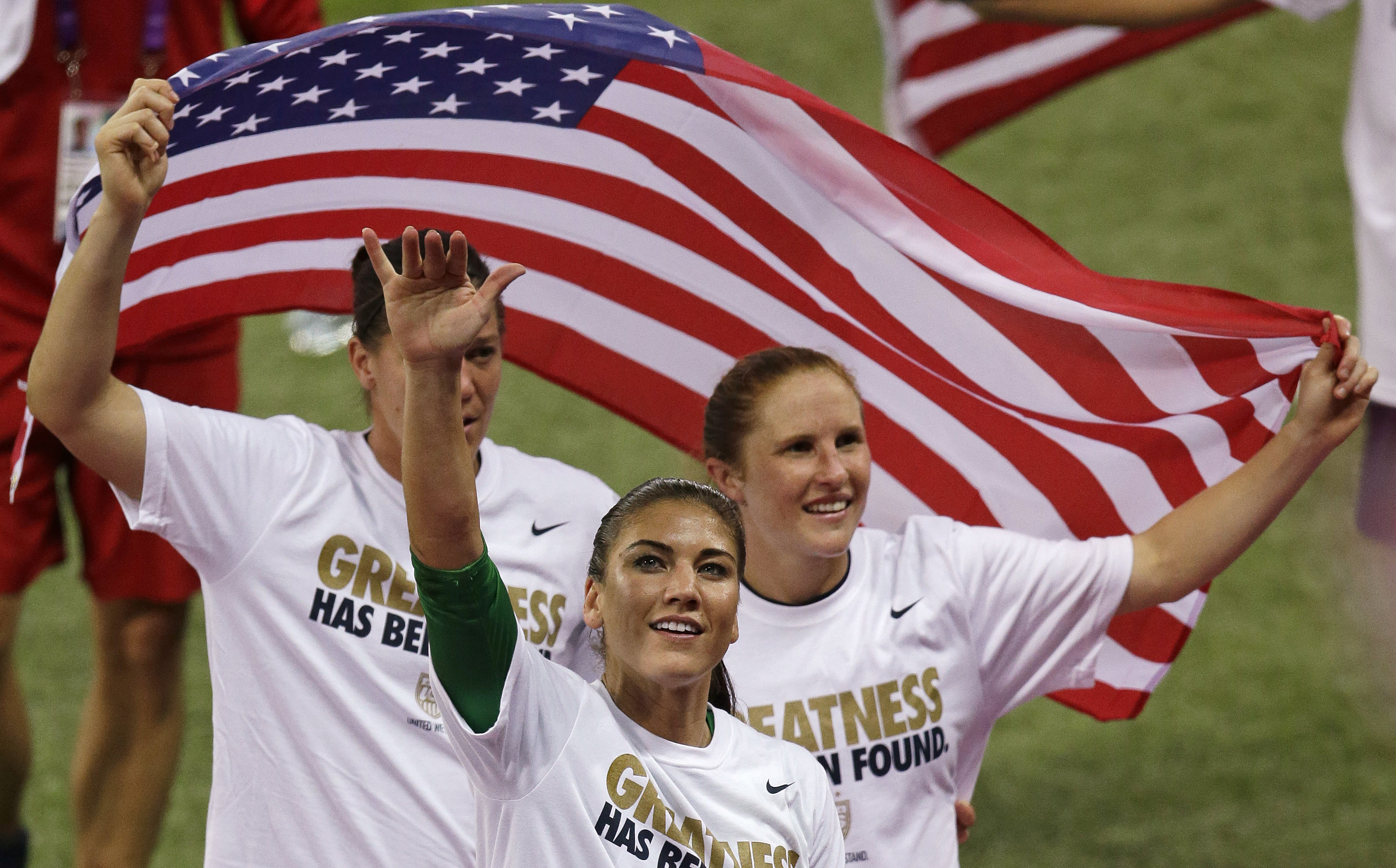 FILE - This Aug. 9, 2012 file photo shows United States goalkeeper Hope Solo celebrating with teammates after winning the gold medal match against Japan at the 2012 Summer Olympics in London. NBC Sports Network will air 330 hours of events during this sum