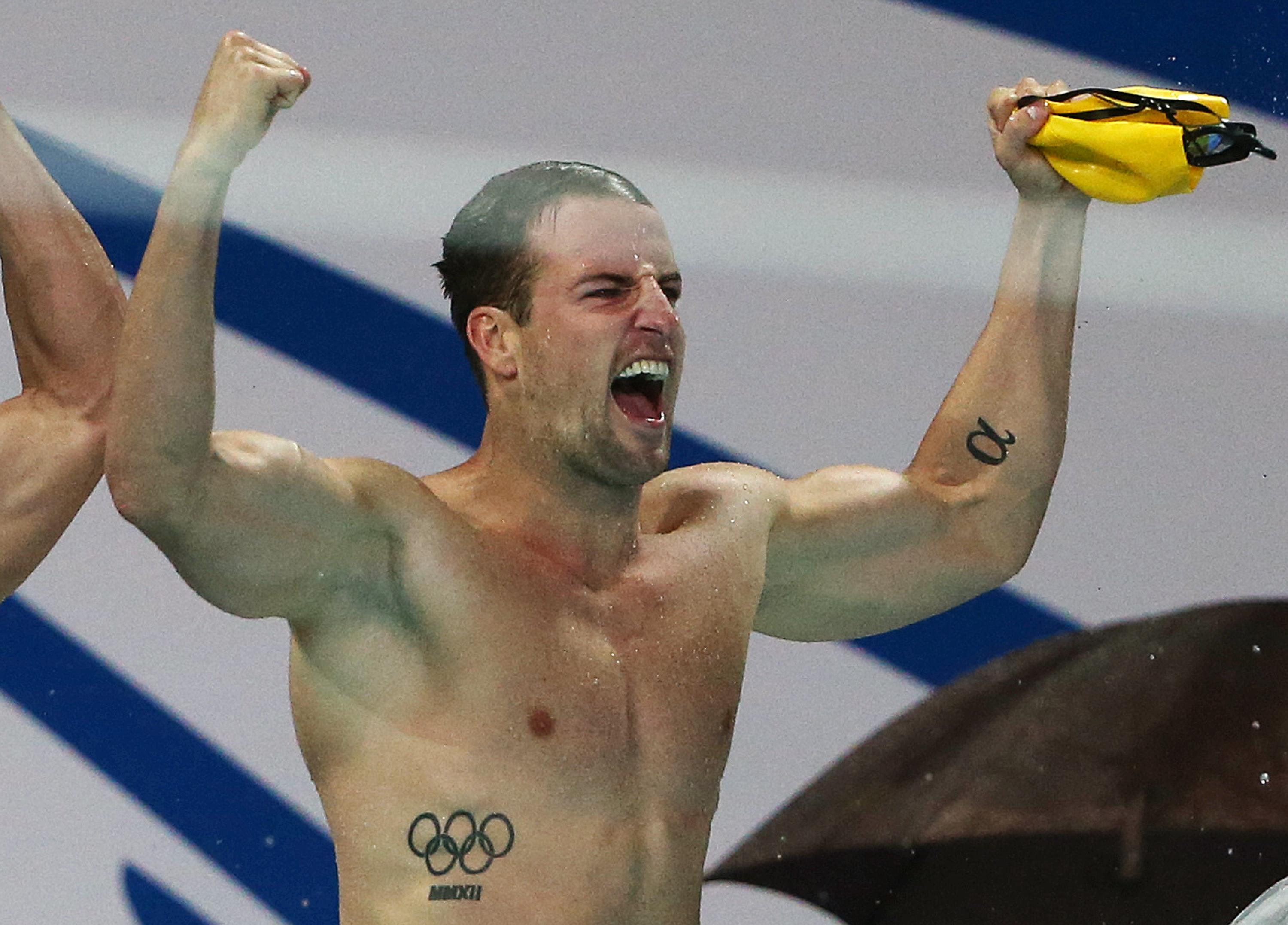 In this Aug. 23, 2014 photo, Australian men's relay team member James Magnussen celebrates winning the men's 4 x 100m freestyle final at the Pan Pacific swimming championships in Gold Coast, Australia. Two-time world champion Magnussen is a late addition