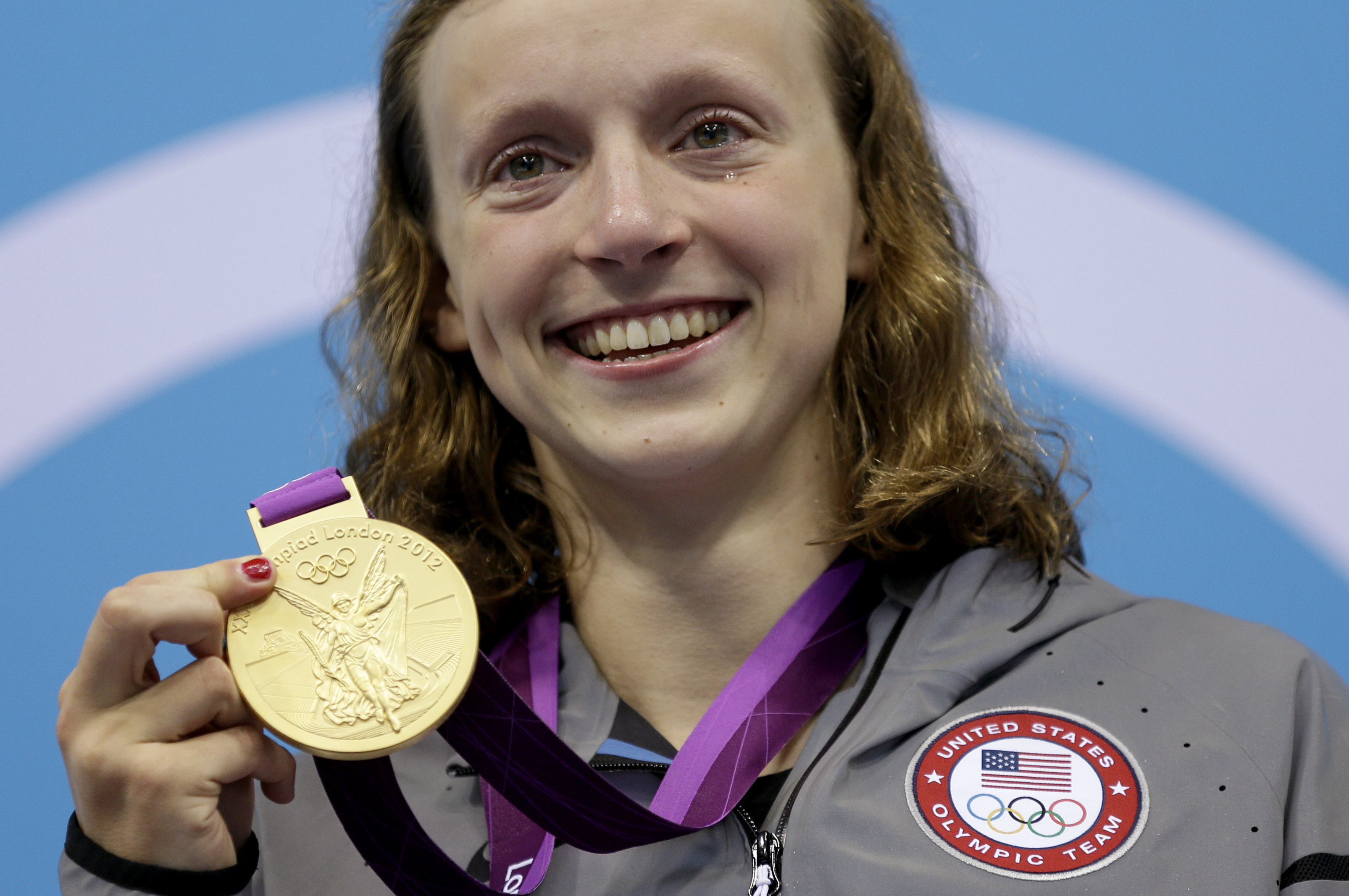 FILE - In this Aug. 3, 2012, file photo, United States' Katie Ledecky poses on the podium with her gold medal in the women's 800-meter freestyle swimming final at the Aquatics Centre in the Olympic Park during the 2012 Summer Olympics in London. Ledecky h