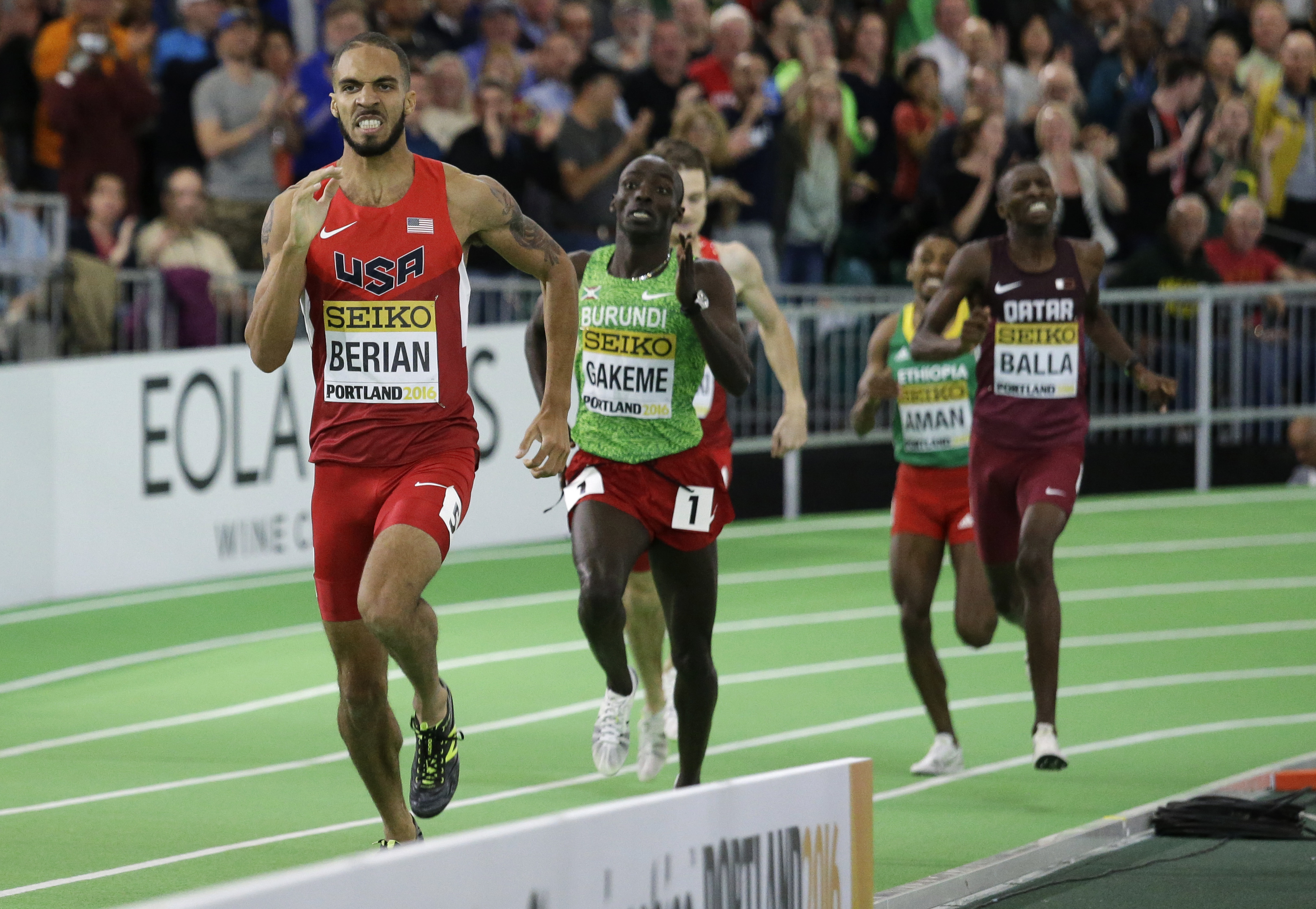 FILE - In this March 9, 2016, file photo, United States' Boris Berian, left, wins the men's 800-meter sprint final during the World Indoor Athletics Championships, in Portland, Ore. Berian has heard all the cute comments about him going from working at Mc