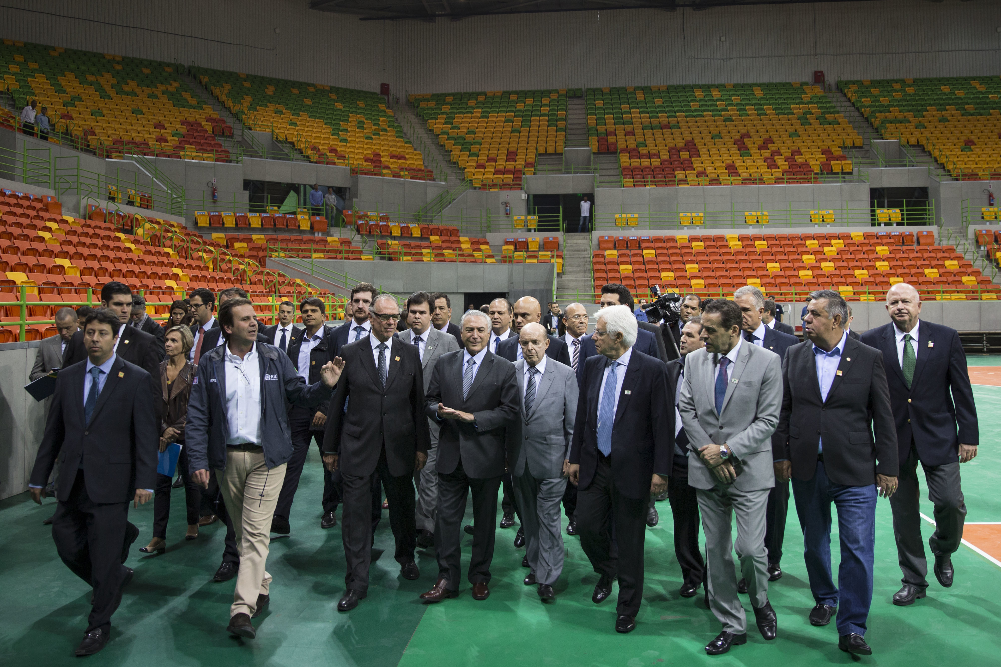 Brazil's interim President Michel Temer, center, walks with officials during a visit to the Olympic Park in Rio de Janeiro, Brazil, Tuesday, June 14, 2016. In recent weeks Temer has stepped up his pledges of support for the Olympic games, which have been