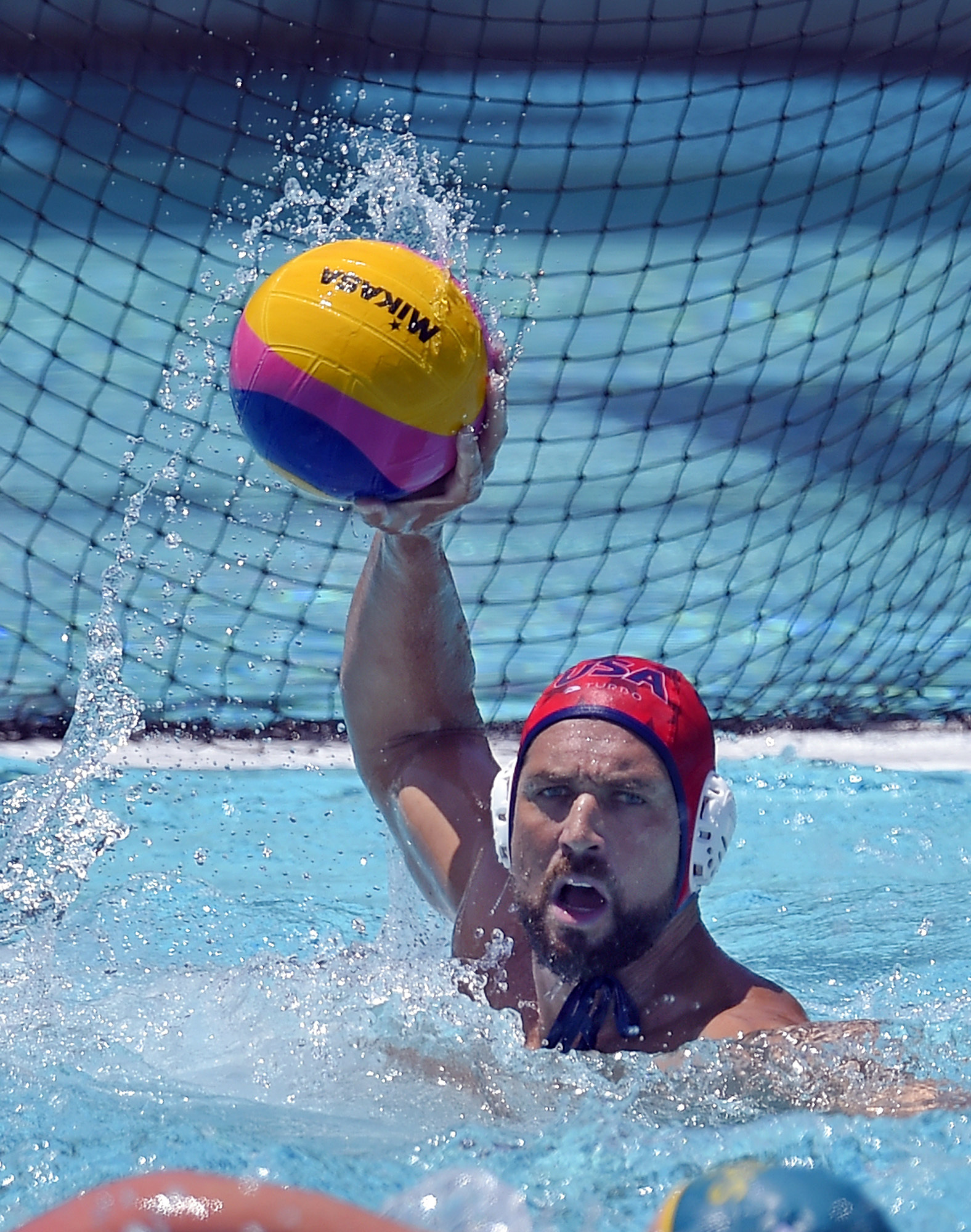 FILE - In this May 22, 2016, file photo, United States goalkeeper Merrill Moses passes the ball during a men's exhibition water polo match against Australia in Los Angeles. Terry Schroeder knows a lot of Merrill Moses stories. One of Schroeder's favorite