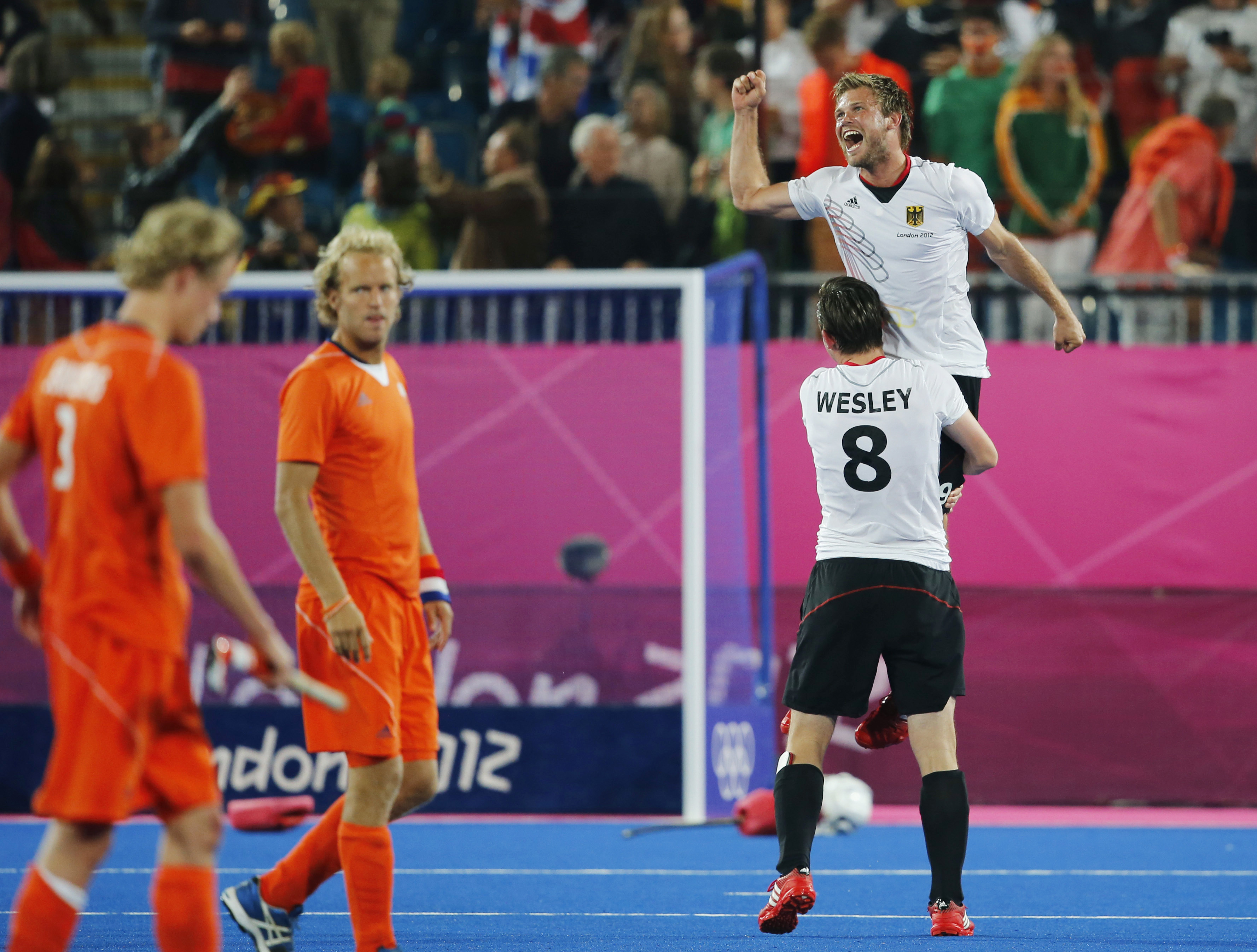 FILE - In this Aug. 11, 2012, file photo, Germany's Christopher Wesley lifts Moritz Fuerste, top right, as they celebrate their victory over the Netherlands in the men's field hockey gold medal match at the 2012 Summer Olympics in London. Germany is looki