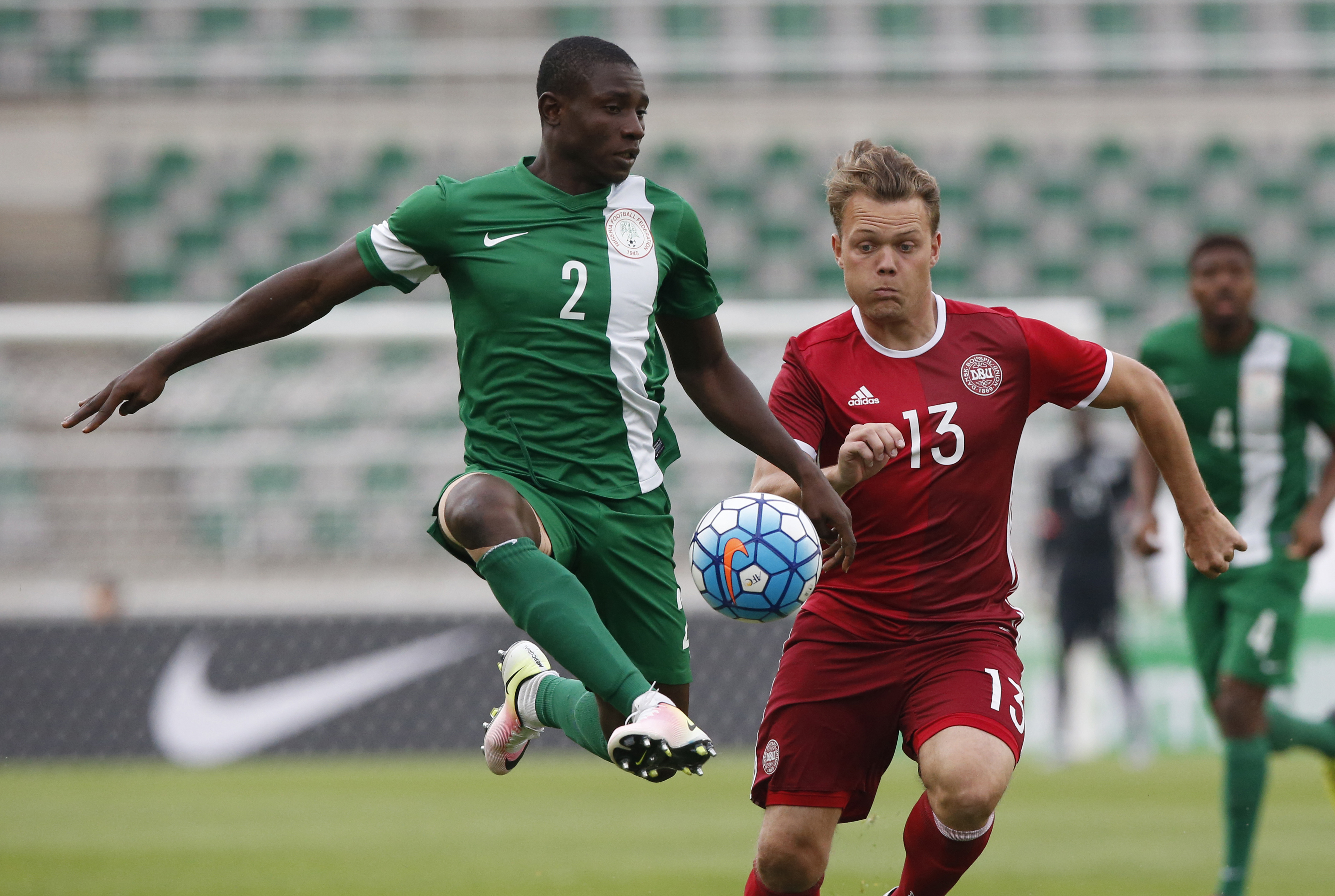 FILE - In this June 4, 2016, file photo, Nigeria's Sincere Muenfuh Seth, left, controls the ball against Denmark's Emil Larsen during a 4 Nations International U-23 soccer tournament at the Goyang Stadium in Goyang, South Korea. African nations have a tra