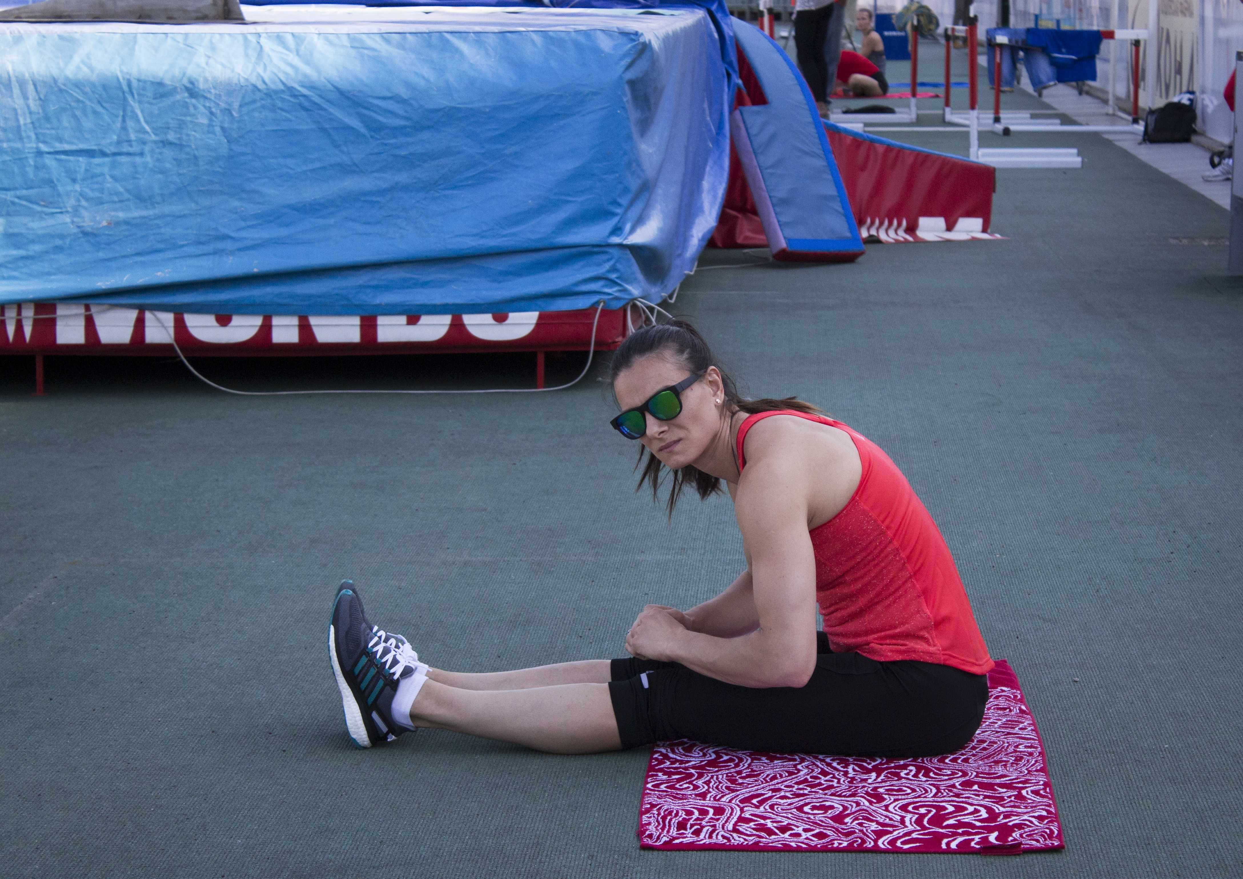 Russia's pole vaulter Yelena Isinbayeva rests after warming up during a training session prior to the National track and field championships at a stadium in Cheboksary, Russia, Sunday, June 19, 2016. The Russian national track and field championships were