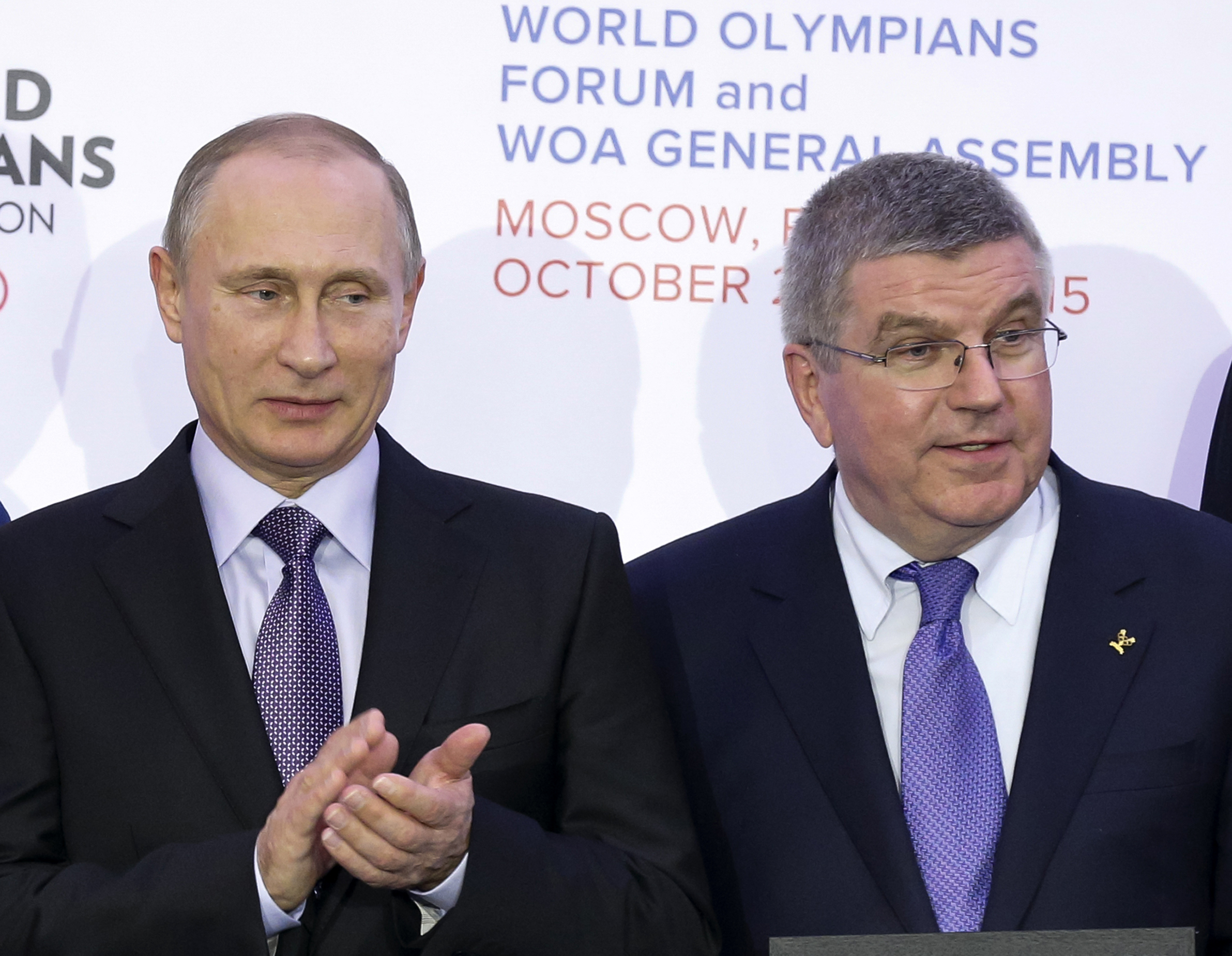 FILE- In this Wednesday, Oct. 21, 2015 file photo, Russian President Vladimir Putin, left, and International Olympic Committee (IOC) President Thomas Bach attend the World Olympians Forum in Moscow, Russia. Olympic leaders on Tuesday, June 21, 2016 have c