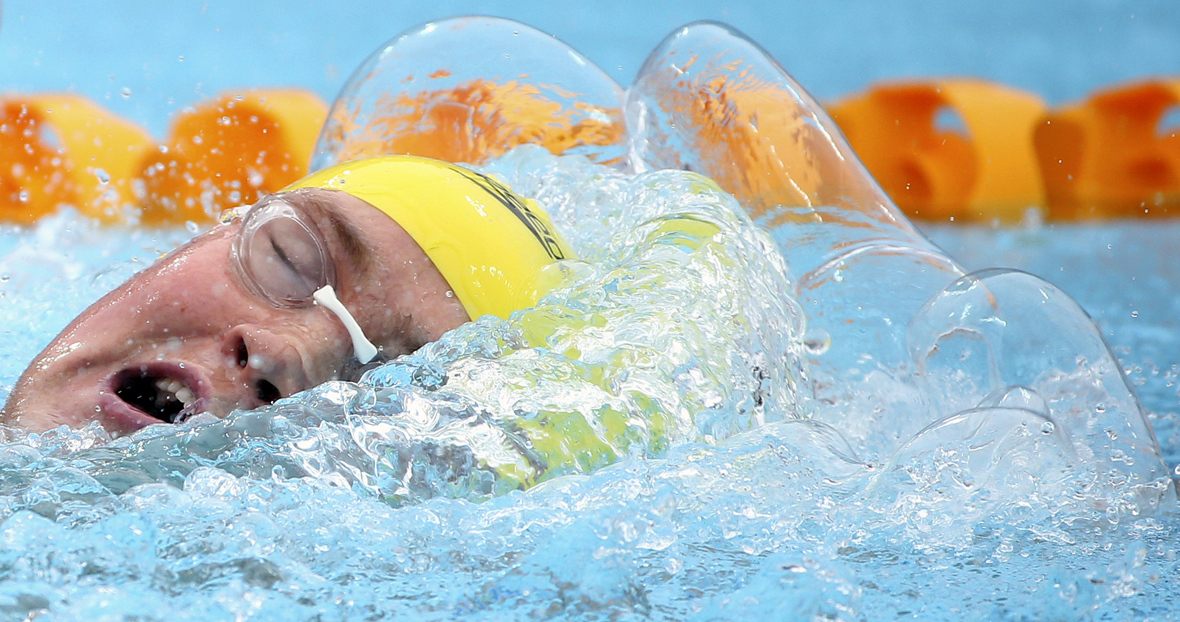 FILE - In this file photo from Aug. 23, 2014, a pressure bubble forms ahead of David McKeon of Australia as he swims a men's 400-meter freestyle heat at the Pan Pacific swimming championships in Gold Coast, Australia. Brother and sister David and Emma McK