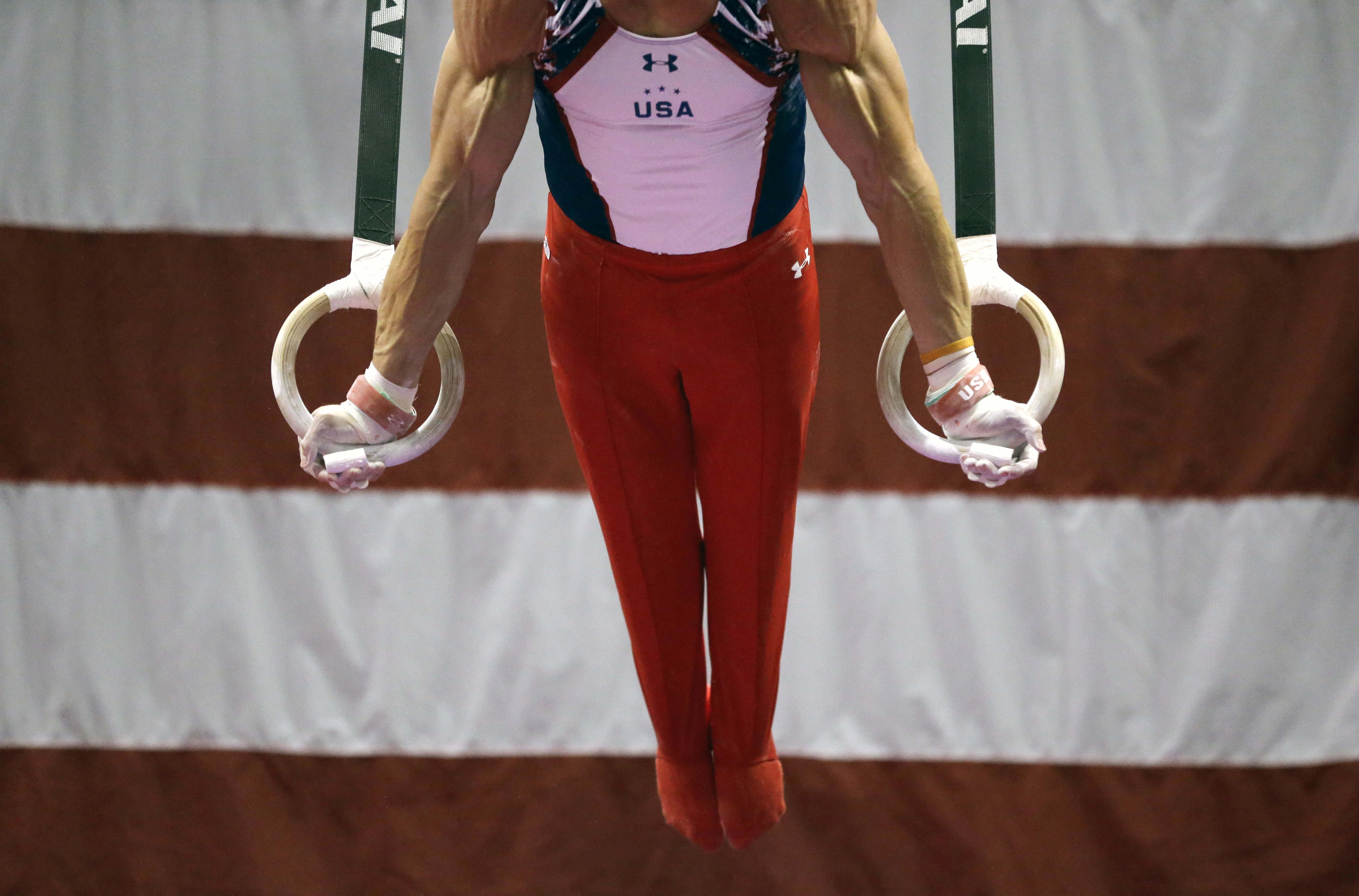 Chris Brooks competes on the rings during the U.S. men's Olympic gymnastics trials Thursday, June 23, 2016, in St. Louis. (AP Photo/Jeff Roberson)