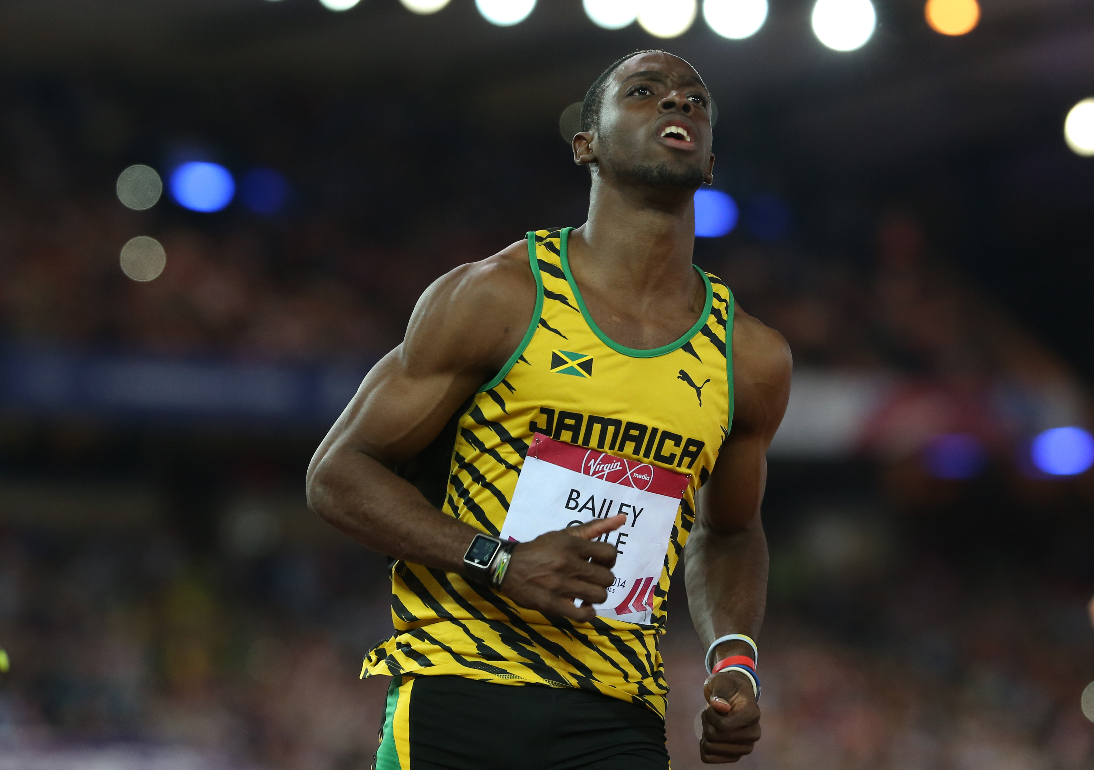 FILE - In this  July 28, 2014 file photo, Kemar Bailey-Cole of Jamaica looks up at a large video screen after winning the men's 100 meter race at Hampden Park stadium during the Commonwealth Games 2014 in Glasgow, Scotland. The Jamaican sprinter says he w