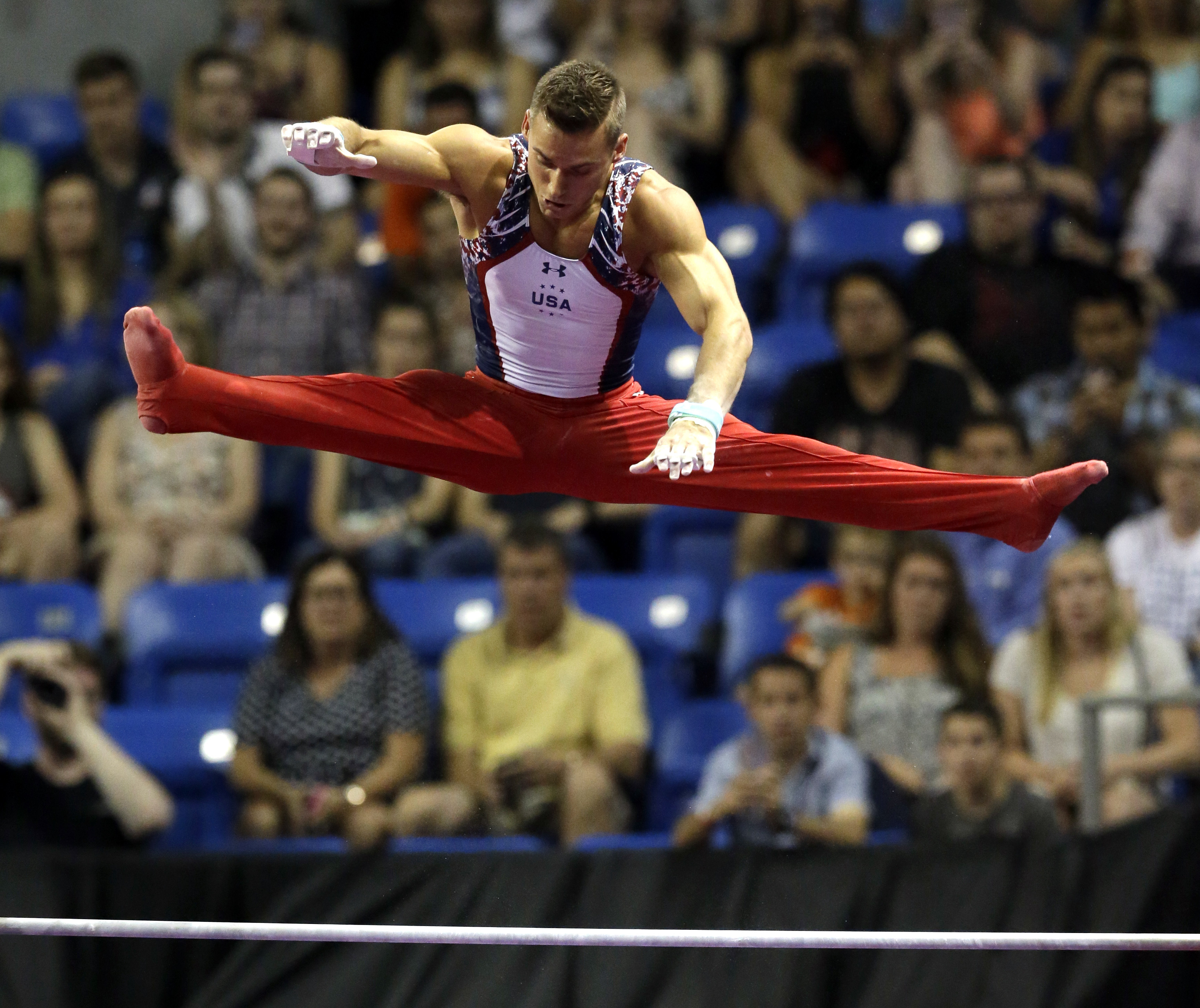 Sam Mikulak competes on the high bar during the U.S. men's Olympic gymnastics trials Saturday, June 25, 2016, in St. Louis. (AP Photo/Jeff Roberson)