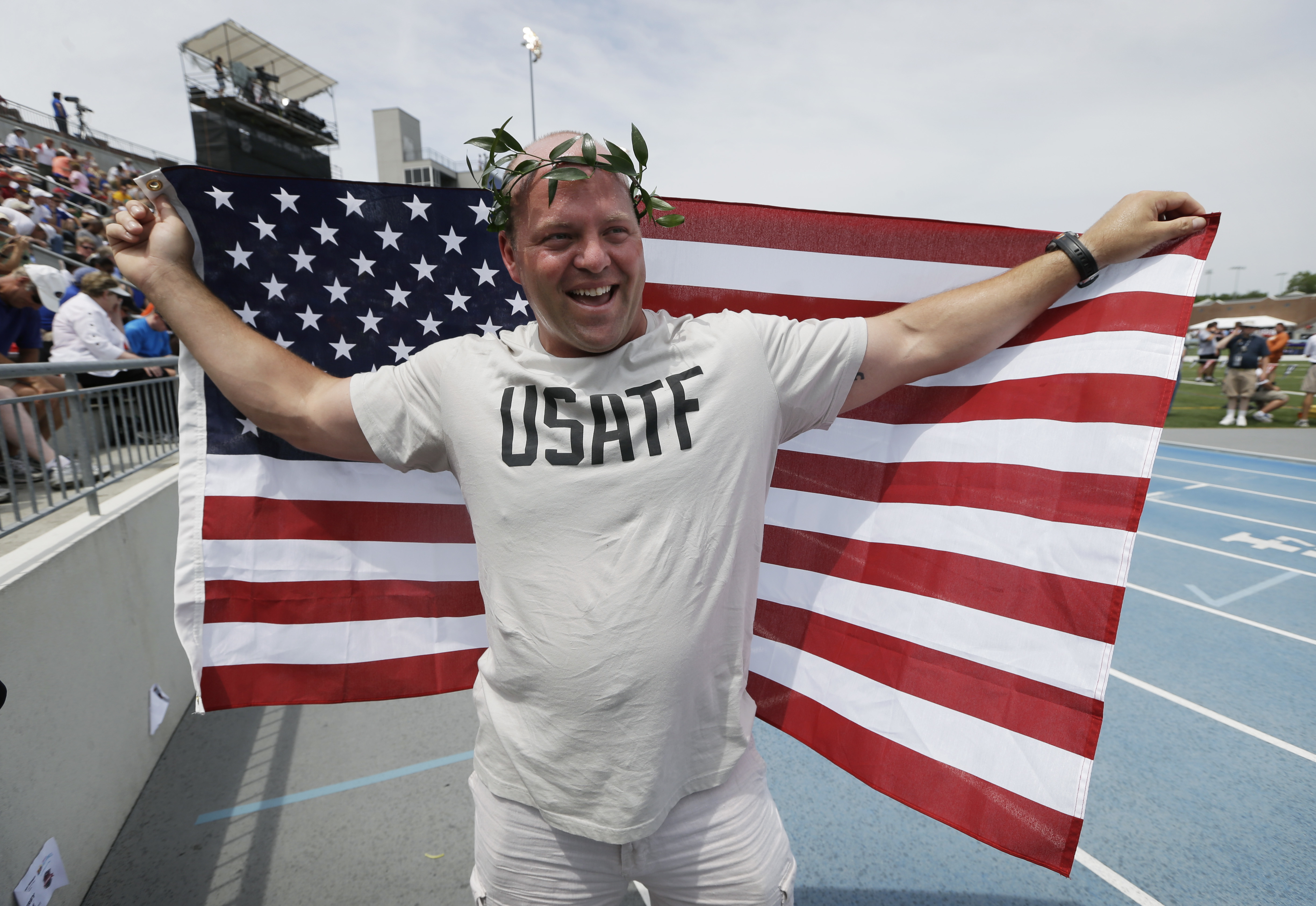 FILE - In this  June 23, 2013, file photo, American shot putter Adam Nelson reacts to the crowd after being honored as the 2004 Olympic champion during a ceremony at the U.S. Championships athletics meet in Des Moines, Iowa. After being retired for nearly