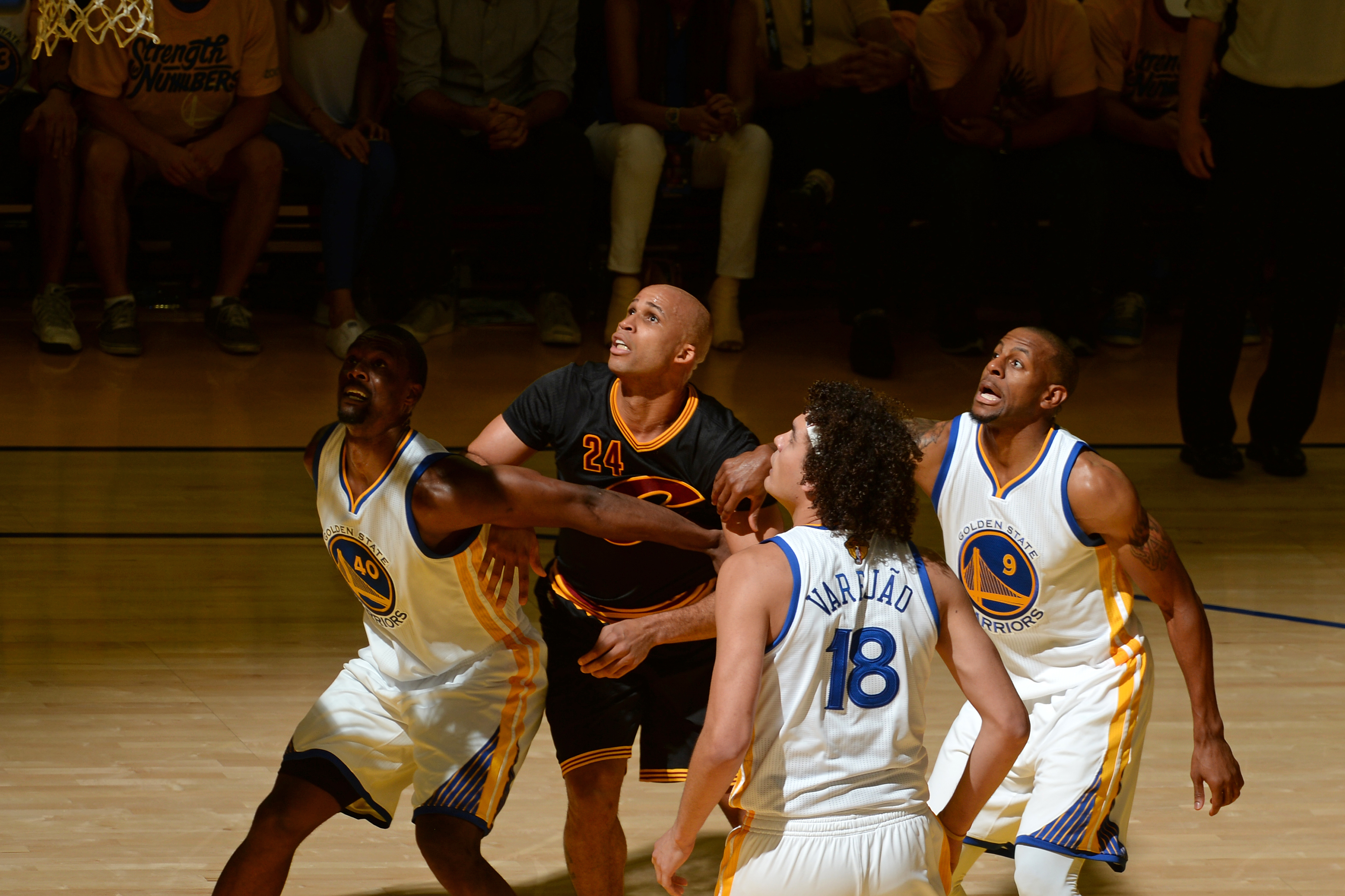 OAKLAND, CA - JUNE 19: Harrison Barnes #40, Anderson Varejao #18, and Andre Iguodala #9 of the Golden State Warriors box out against Richard Jefferson #24 of the Cleveland Cavaliers during the 2016 NBA Finals on June 19, 2016 at Oracle Arena in Oakland, C