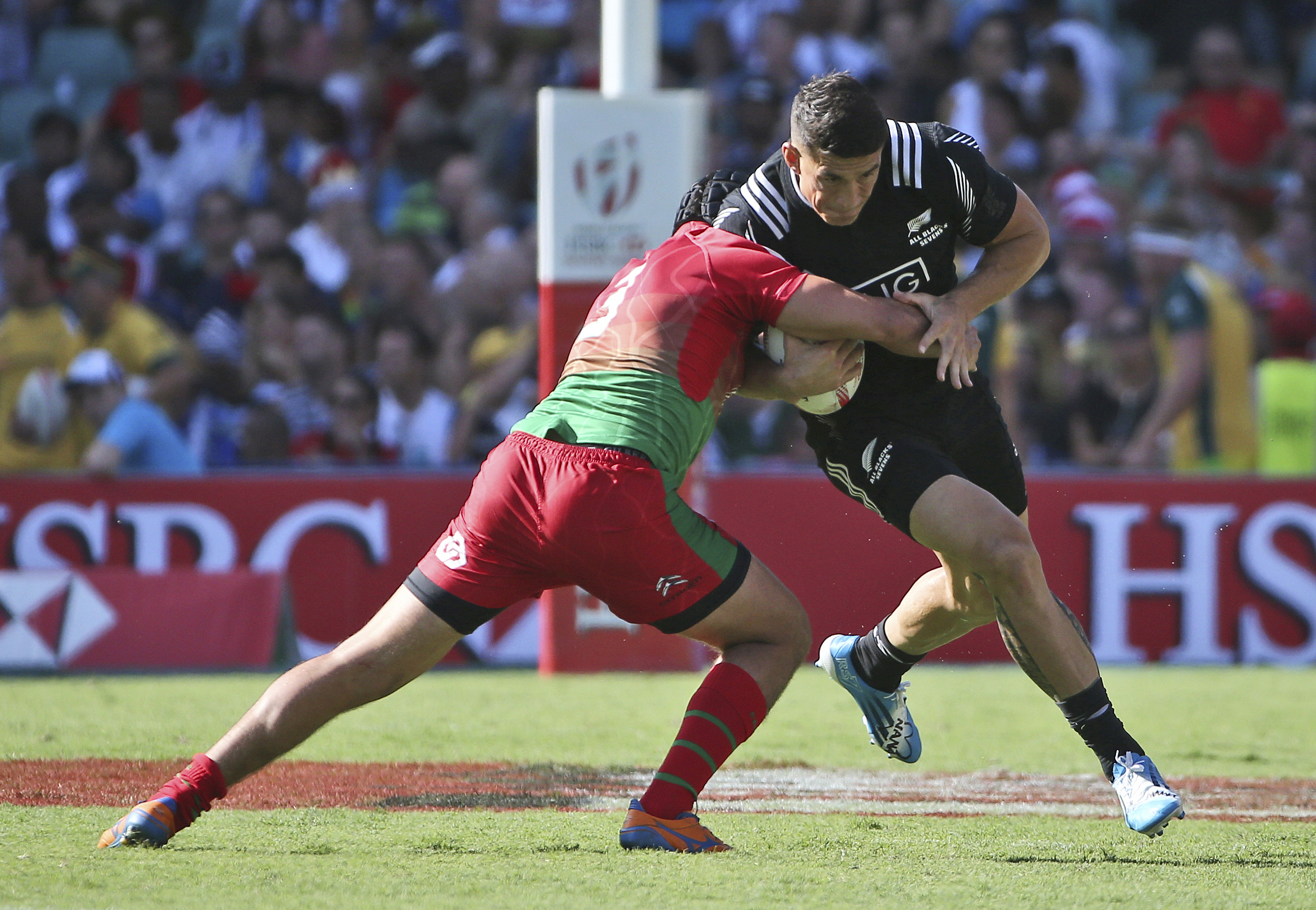 FILE - In this Feb. 6, 2016 file photo Miguel Lucas of Portugal, left, tackles Sonny Bill Williams of New Zealand during the World Rugby Sevens Series in Sydney, Australia. Rugby is returning to the Olympics for the first time in 92 years with a abbreviat