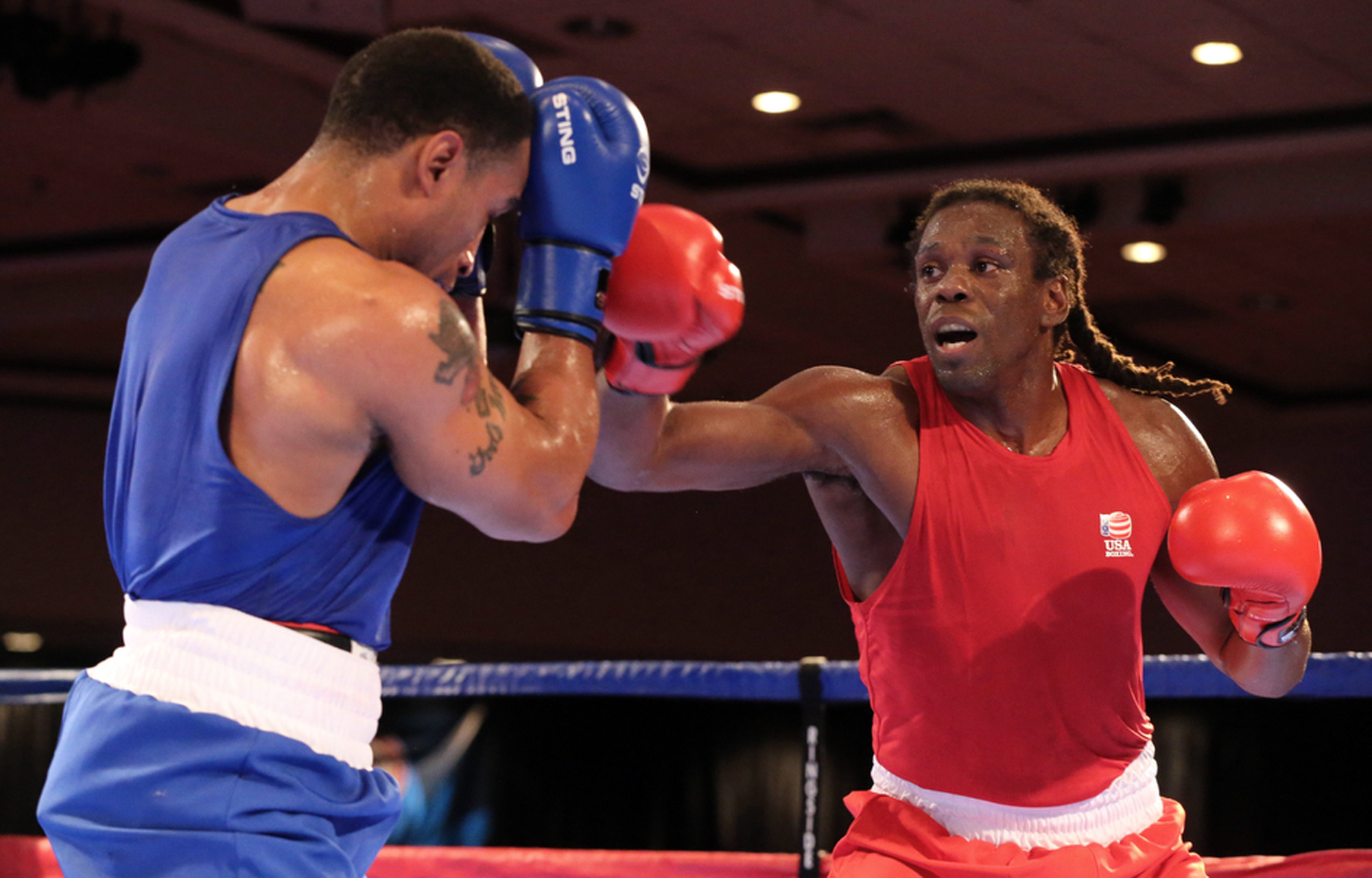 In this  Dec. 9, 2015, file photo, Derae Crane and Cam Awesome, right, compete in the U.S. Olympic boxing  trials in Reno, Nev. Awesome is down to his last chance to qualify for Rio. The colorful American heavyweight has to win a tournament that starts Su