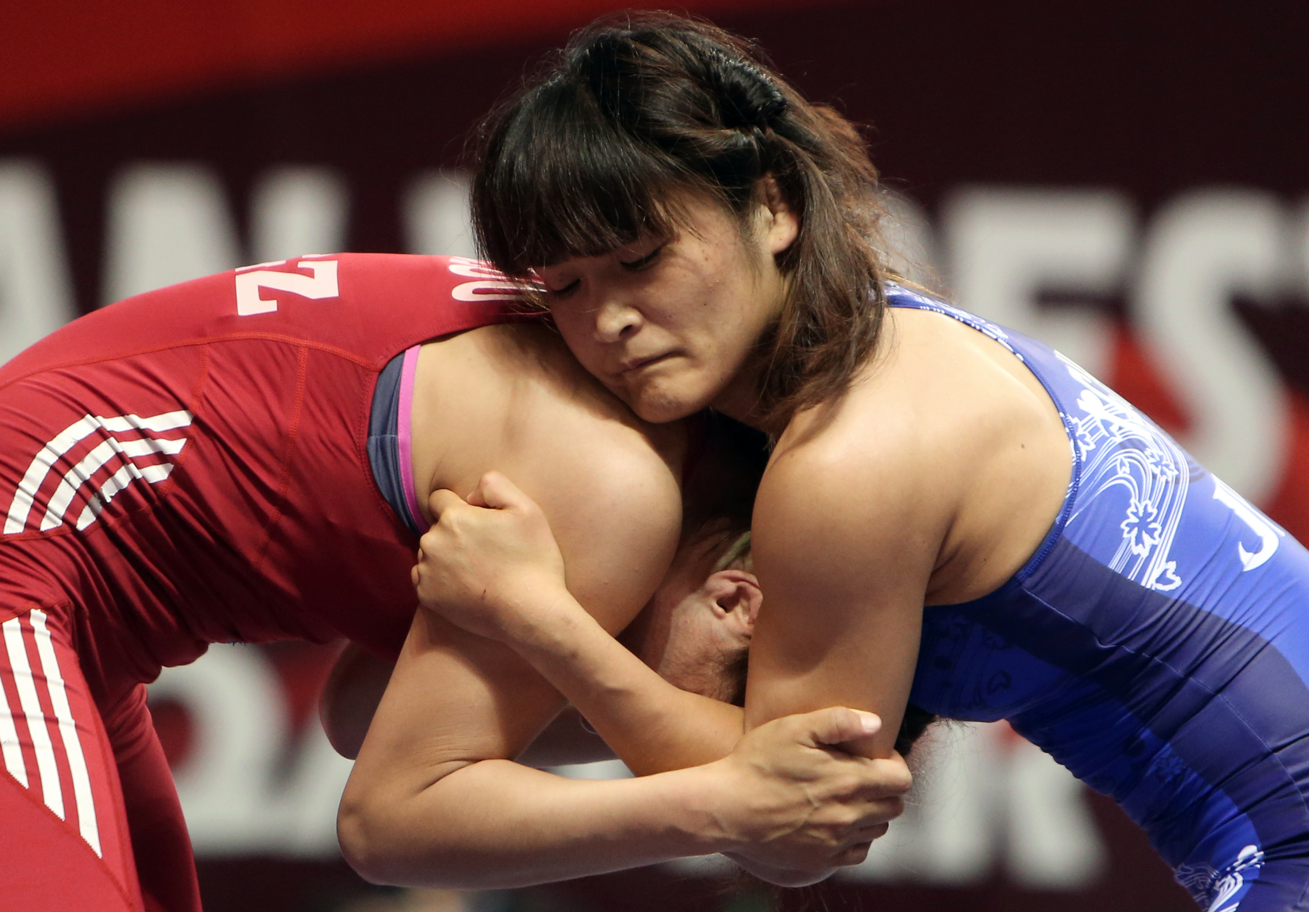 FILE - In this May 6, 2015, file photo, Japan's Kaori Icho, right, battles Kyrgyzstan's Aisuluu Tynybekova of Kyrgyzstan during the final of the 65 kilogram category at the Asian Championship of wrestling in Doha, Qatar. Japans Kaori Icho and Saori Yoshid
