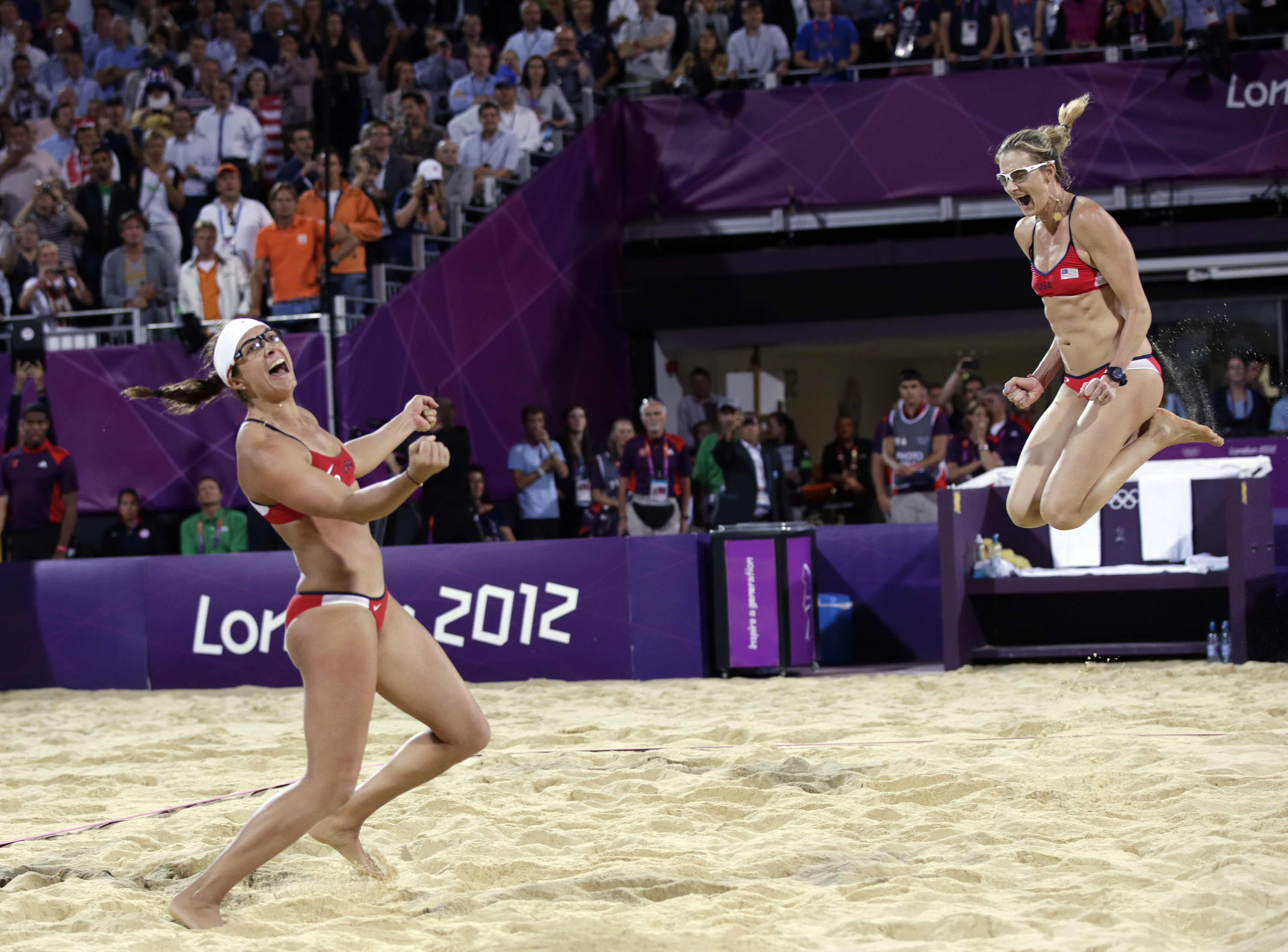 FILE - In this Aug. 8, 2012, file photo, Miss May Treanor, left, and Kerri Walsh Jennings celebrate a win over April Ross and Jennifer Kessy during the women's Gold Medal beach volleyball match at the 2012 Summer Olympics in London.  When longtime partner