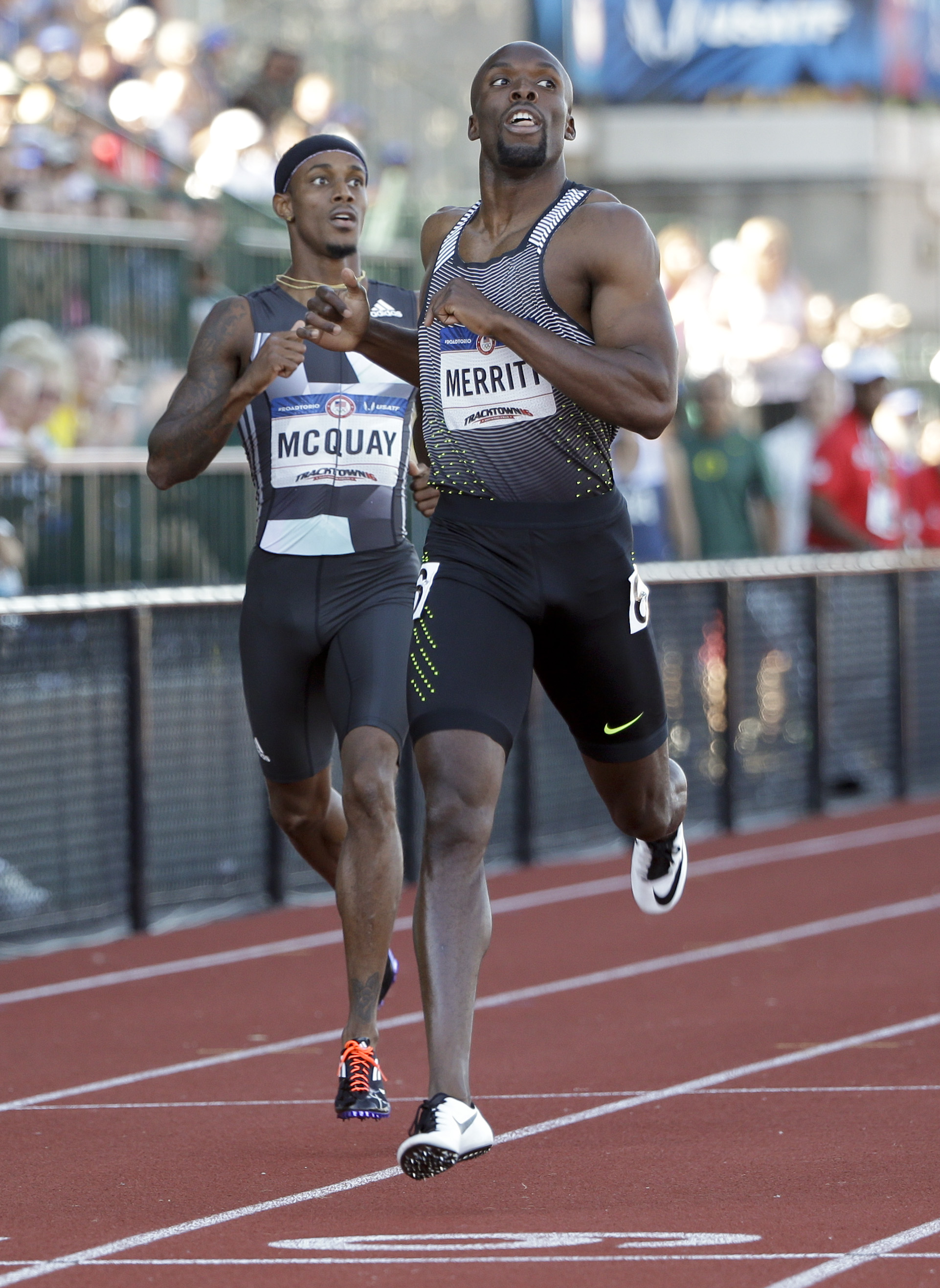 LaShawn Merritt, right, wins his heat during qualifying for men's 400-meter run at the U.S. Olympic Track and Field Trials, Friday, July 1, 2016, in Eugene Ore. (AP Photo/Marcio Jose Sanchez)