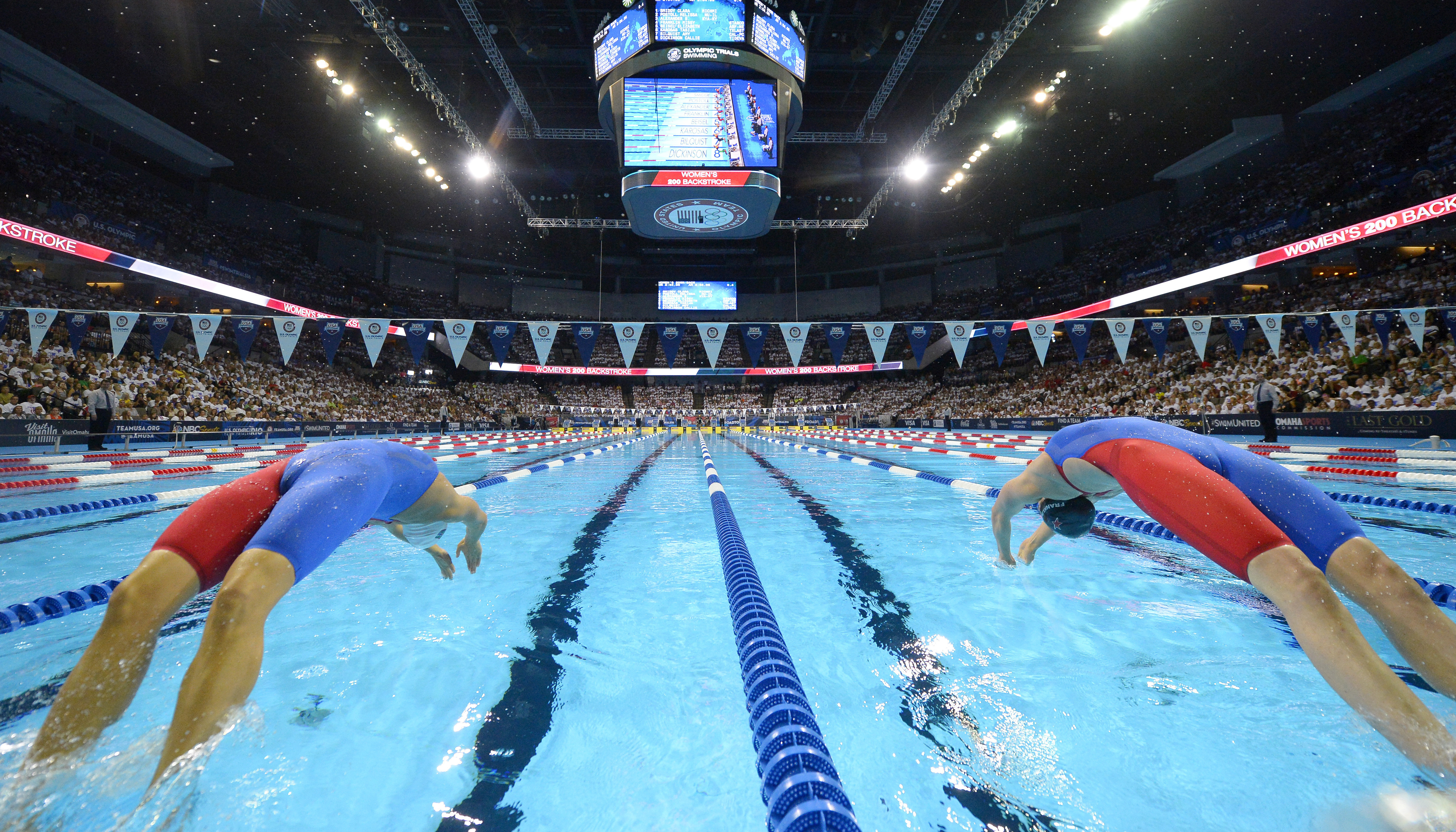 Elizabeth Beisel, left, and Missy Franklin start the women's 200-meter backstroke semifinal at the U.S. Olympic swimming trials, Friday, July 1, 2016, in Omaha, Neb. (AP Photo/Mark J. Terrill)