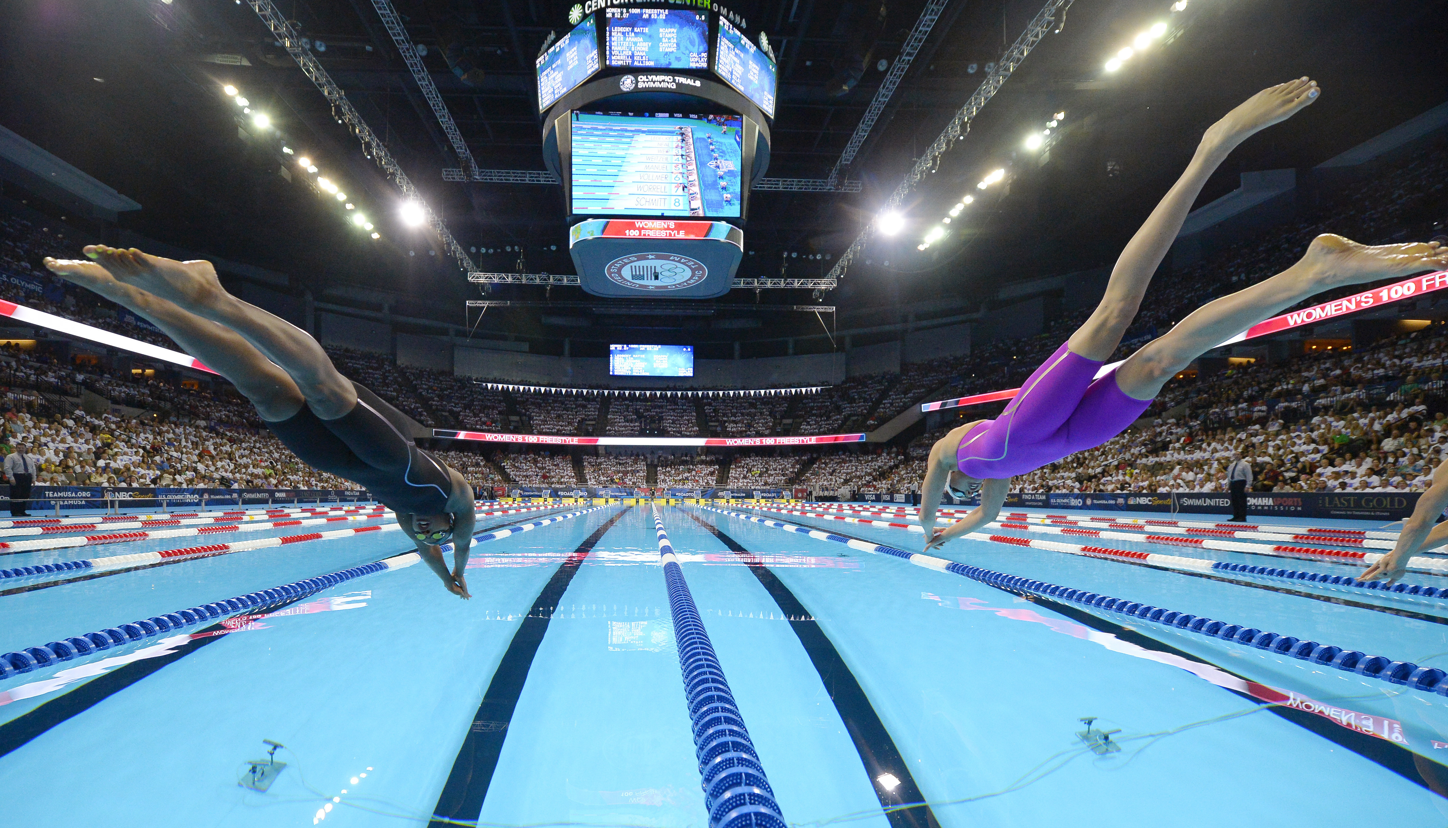Simone Manuel, left, and Abbey Weitzeil start the women's 100-meter freestyle final at the U.S. Olympic swimming trials, Friday, July 1, 2016, in Omaha, Neb. (AP Photo/Mark J. Terrill)