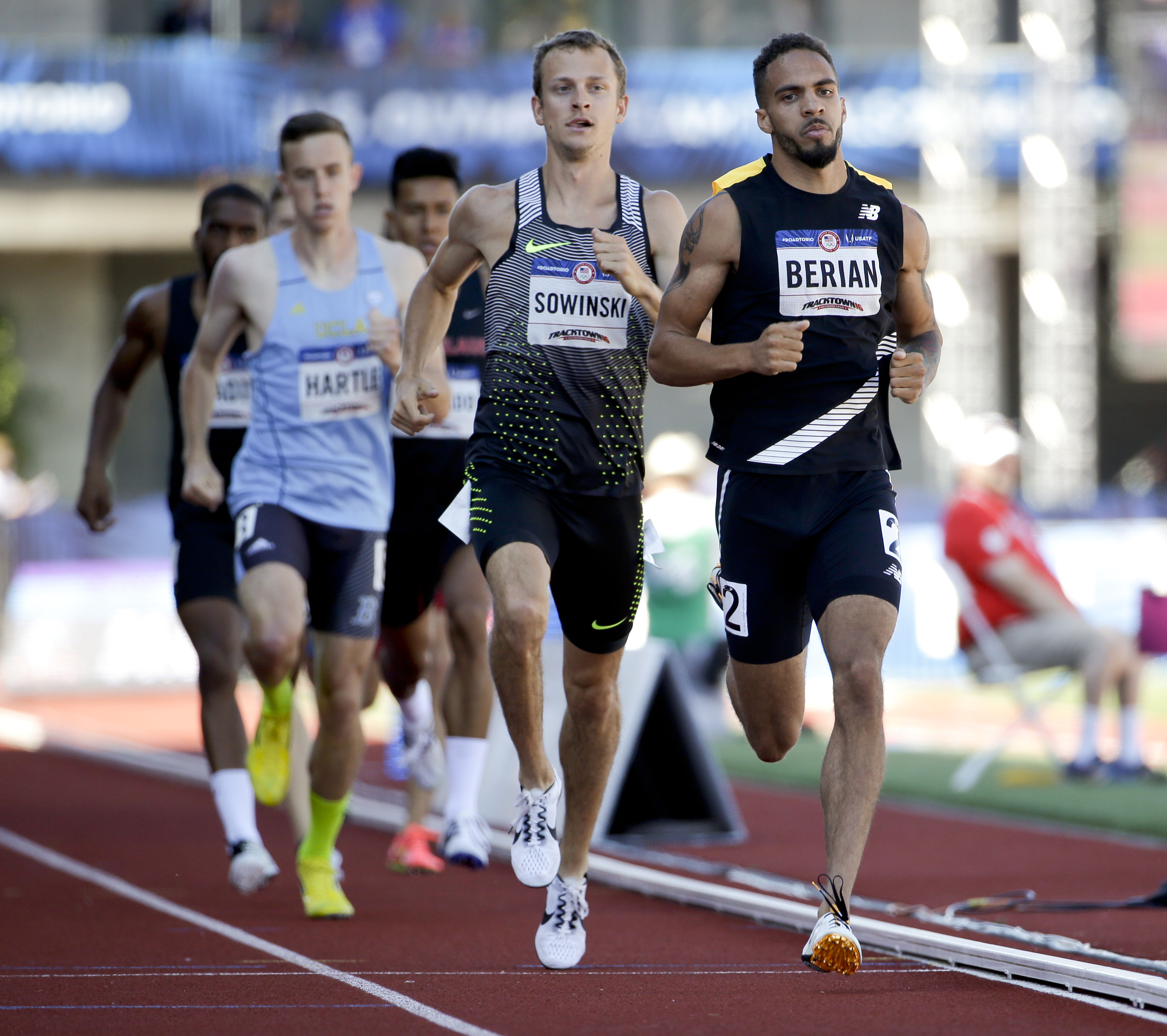 Boris Berian, right, wins his heat during qualifying for men's 800-meter run at the U.S. Olympic Track and Field Trials, Friday, July 1, 2016, in Eugene Ore. (AP Photo/Marcio Jose Sanchez)