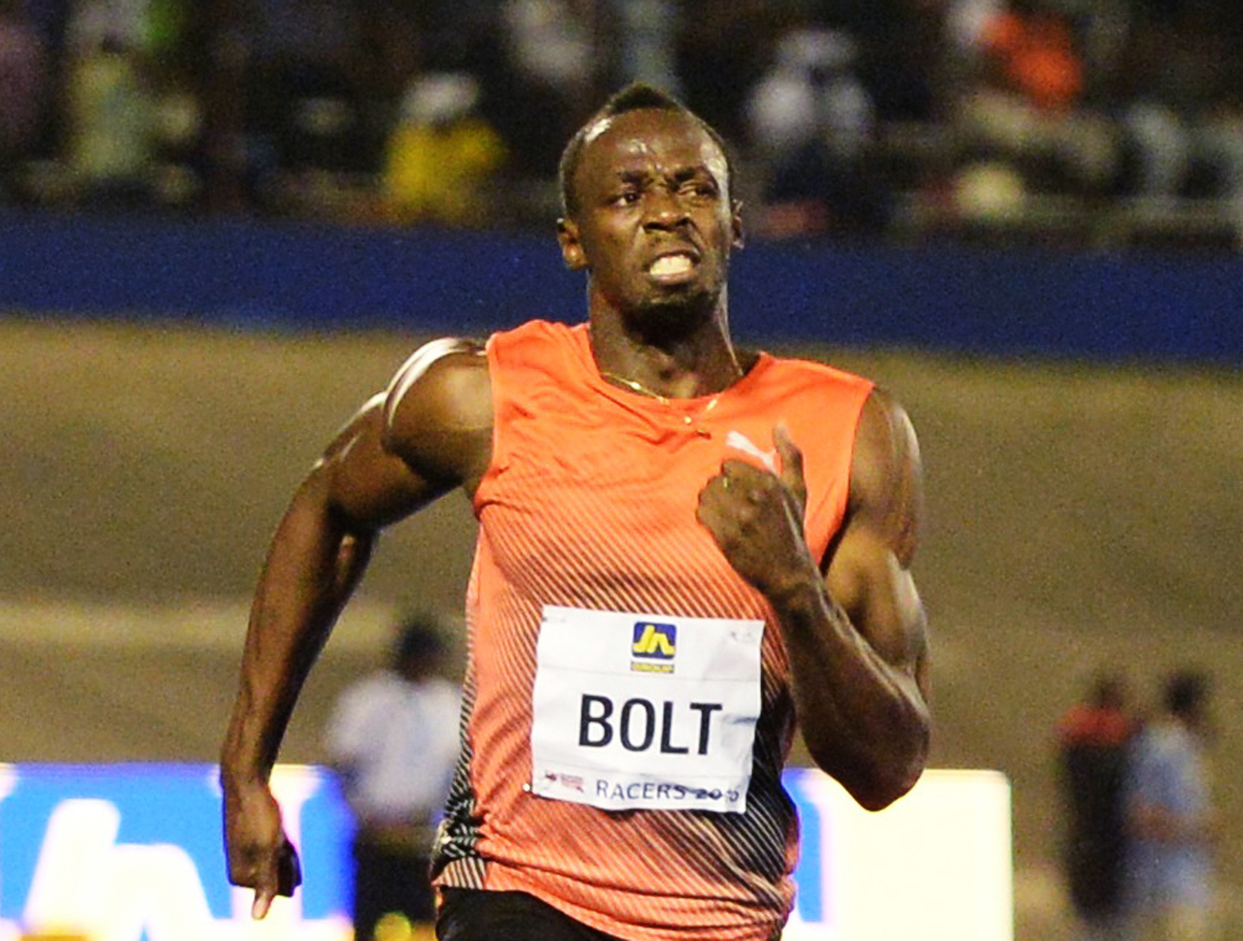 Usain Bolt, of Jamaica, wins the 100-meter final ahead of Yohan Blake and Asafa Powell, both of Jamaica, in the Racers Grand Prix track and field event at the National Stadium in Kingston, Jamaica, Saturday, June 11, 2016. (AP Photo/Collin Reid)