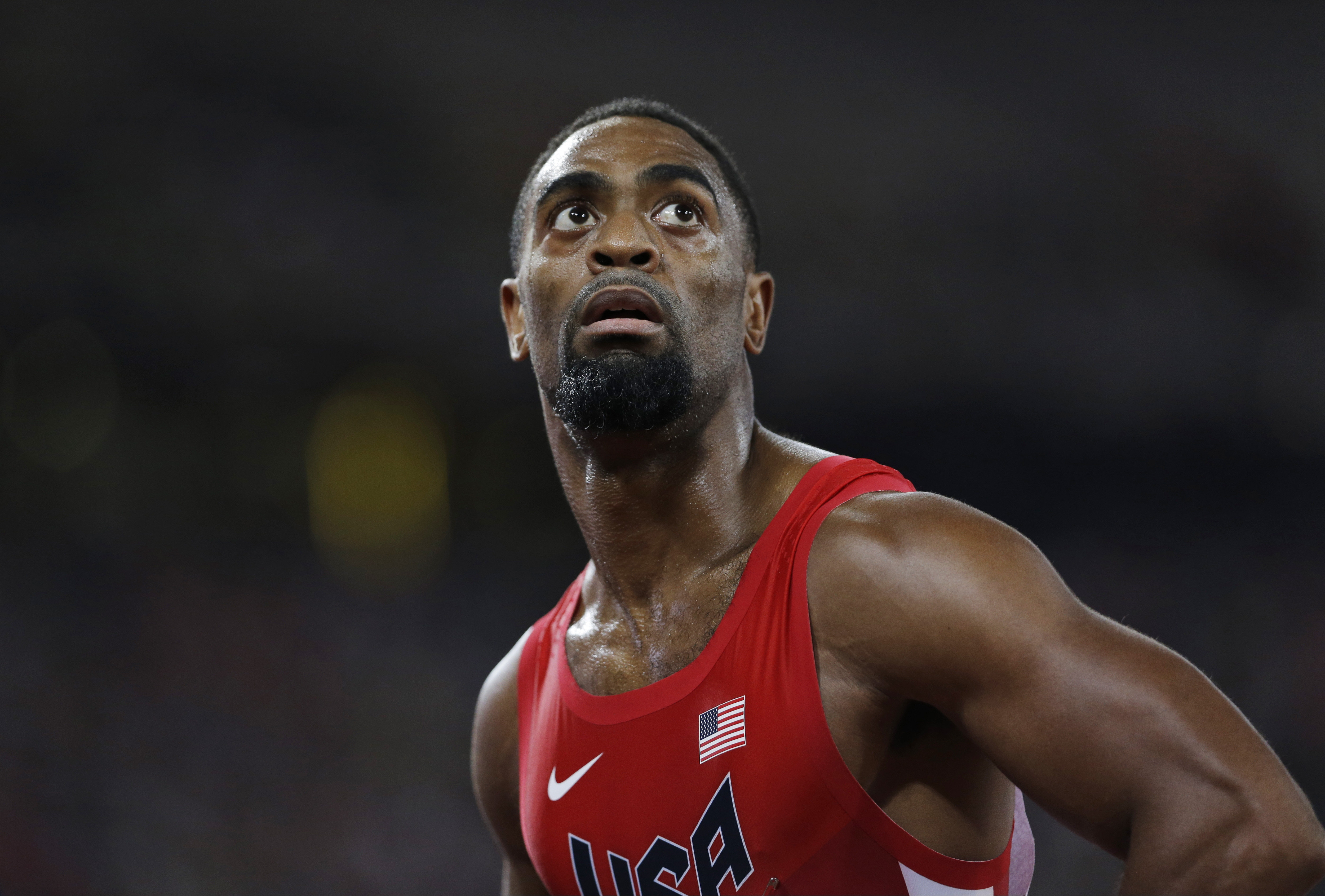 FILE - In this Aug. 23, 2015, file photo, United States' Tyson Gay looks at his time from a men's 100-meter semifinal at the World Athletics Championships at the Bird's Nest stadium in Beijing. The man who used to be considered the biggest threat to Usain