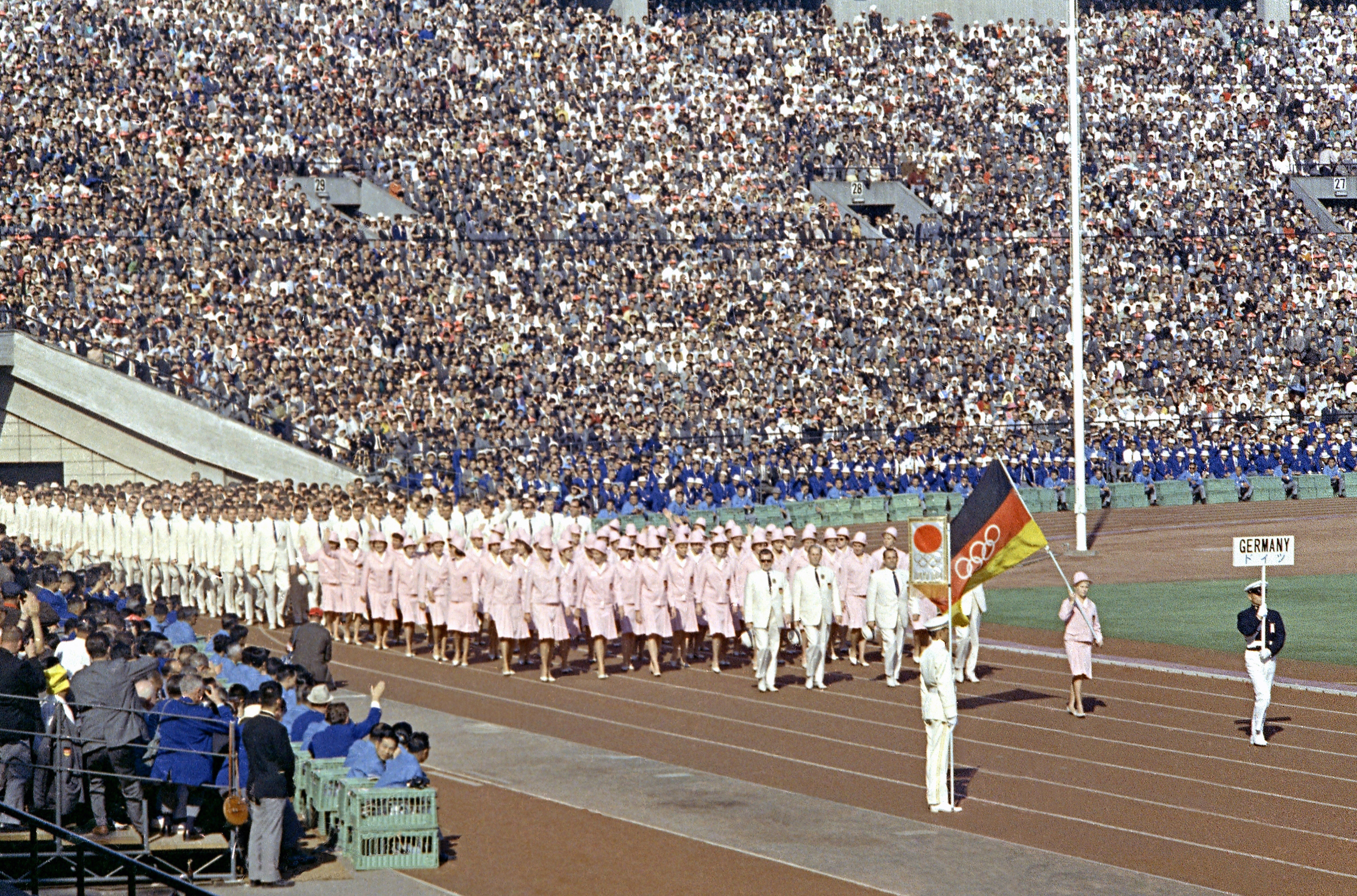 FILE - In this Oct. 10, 1964, file photo, the United Team of Germany enters the Olympic Stadium at the opening ceremony of the Summer Olympic Games in Tokyo, Japan. While Germany was a divided country, West Germany and East Germany, from 1956 to 1964, cam