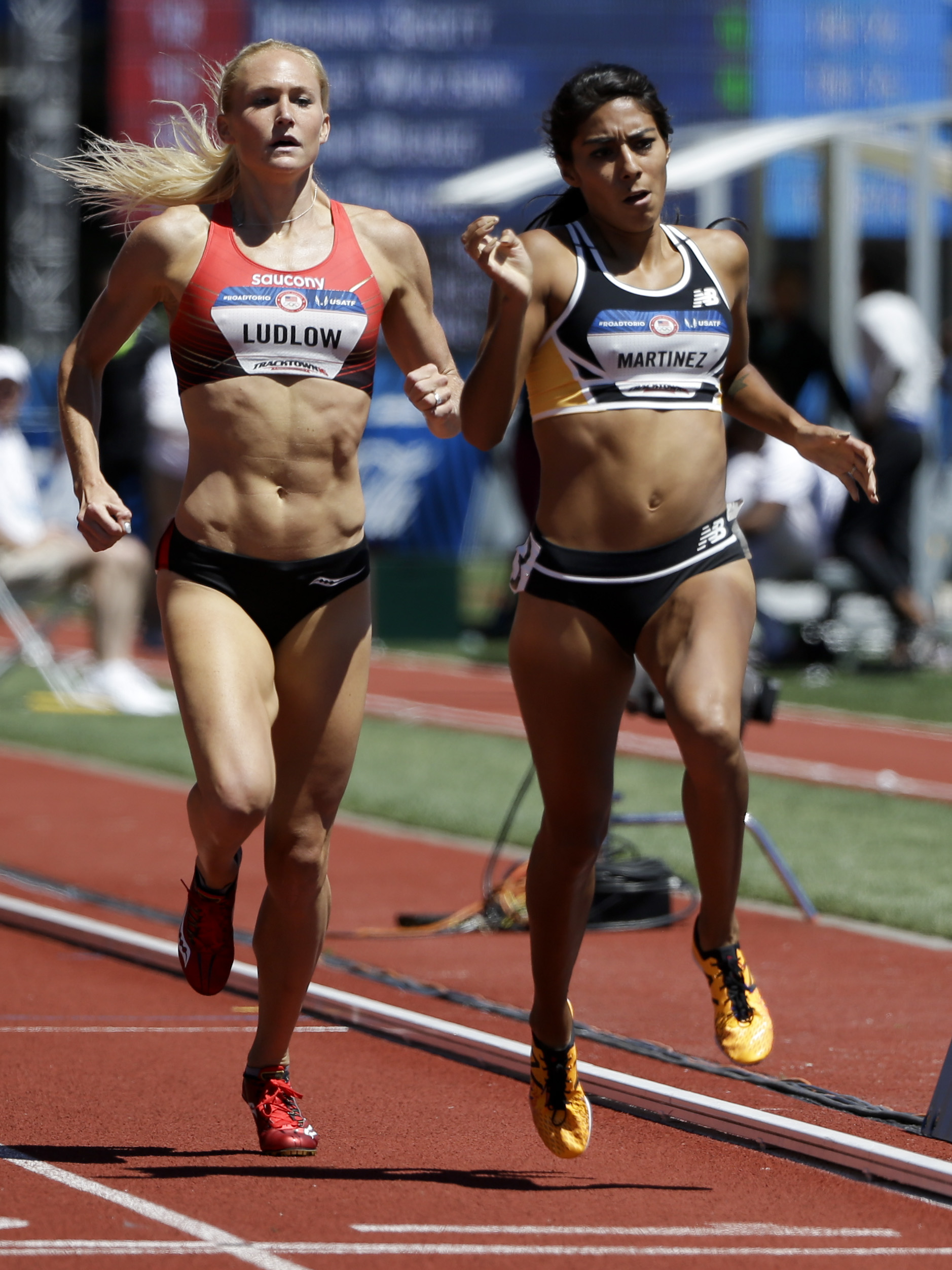 Brenda Martinez, right, wins her heat past Molly Ludlow during qualifying for women's 800-meter run at the U.S. Olympic Track and Field Trials, Saturday, July 2, 2016, in Eugene Ore. (AP Photo/Marcio Jose Sanchez)