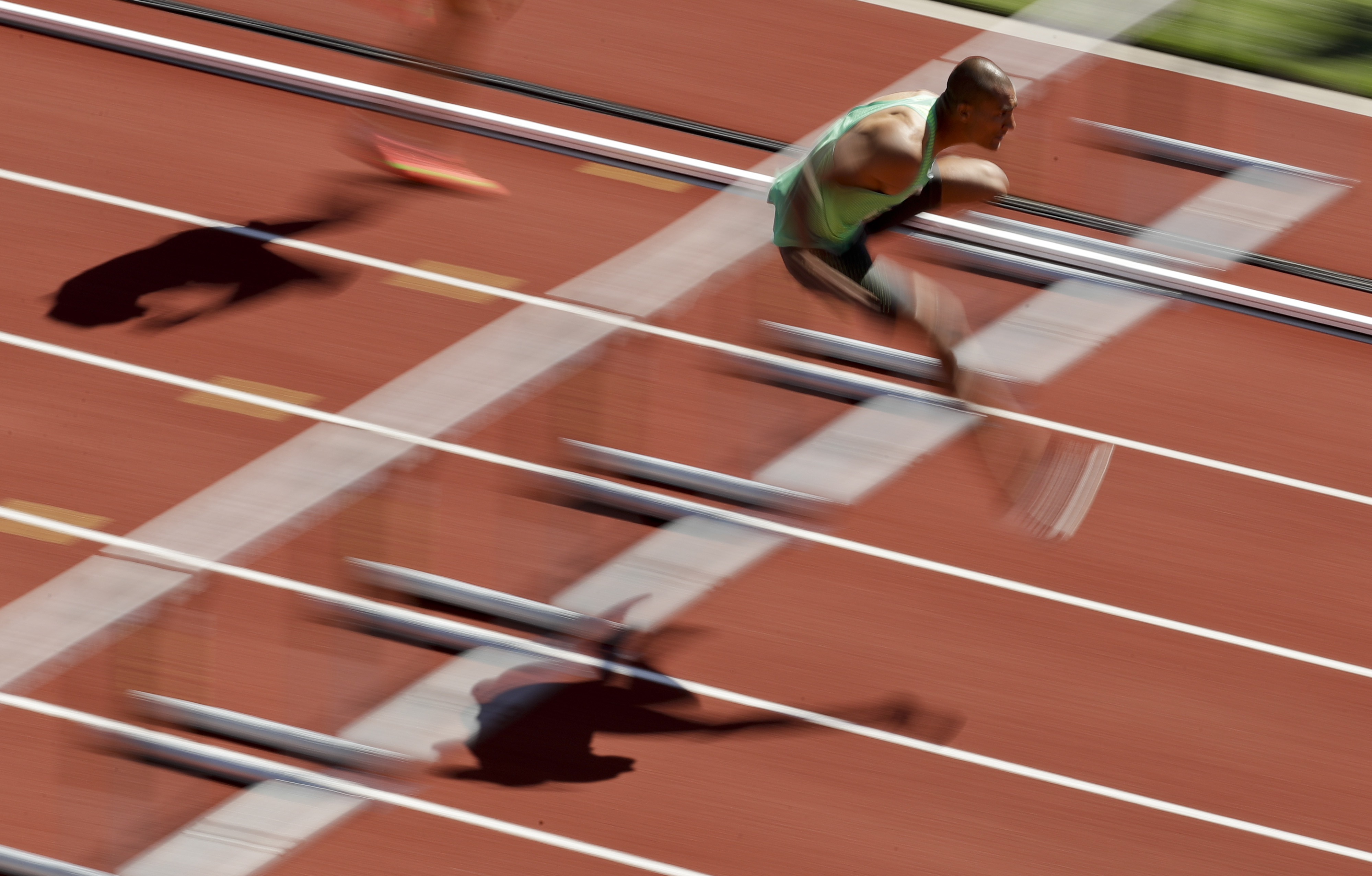 Ashton Eaton competes during the decathlon 110-meter hurdles at the U.S. Olympic Track and Field Trials, Sunday, July 3, 2016, in Eugene Ore. (AP Photo/Charlie Riedel)