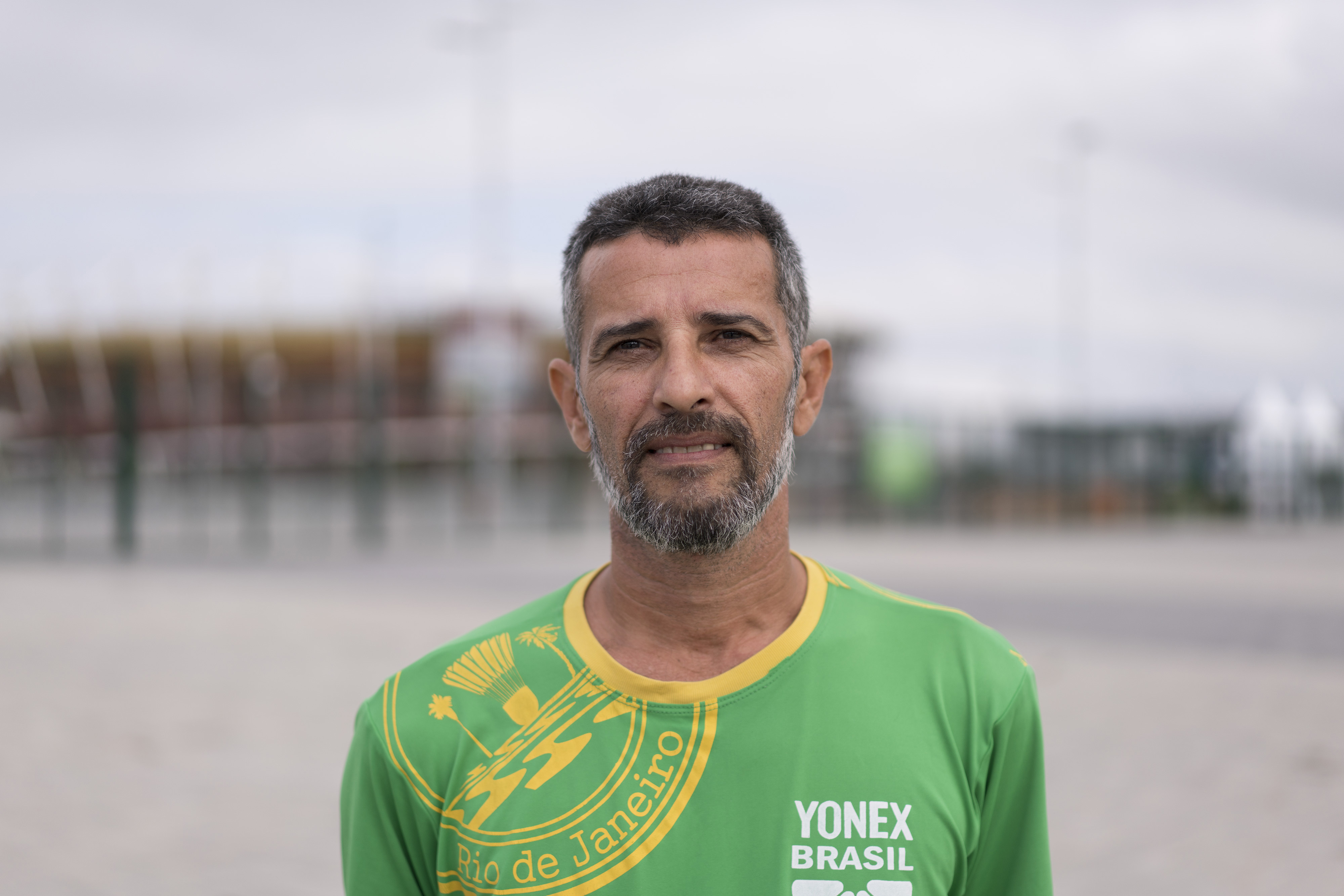 In this June 3, 2016 photo, Marco Araujo, badminton coach of the Rio de Janeiro state badminton federation, poses for a photo in Rio de Janeiro, Brazil. The Olympics are bringing an incomparable legacy, in regard to the changes in the city's infrastructur