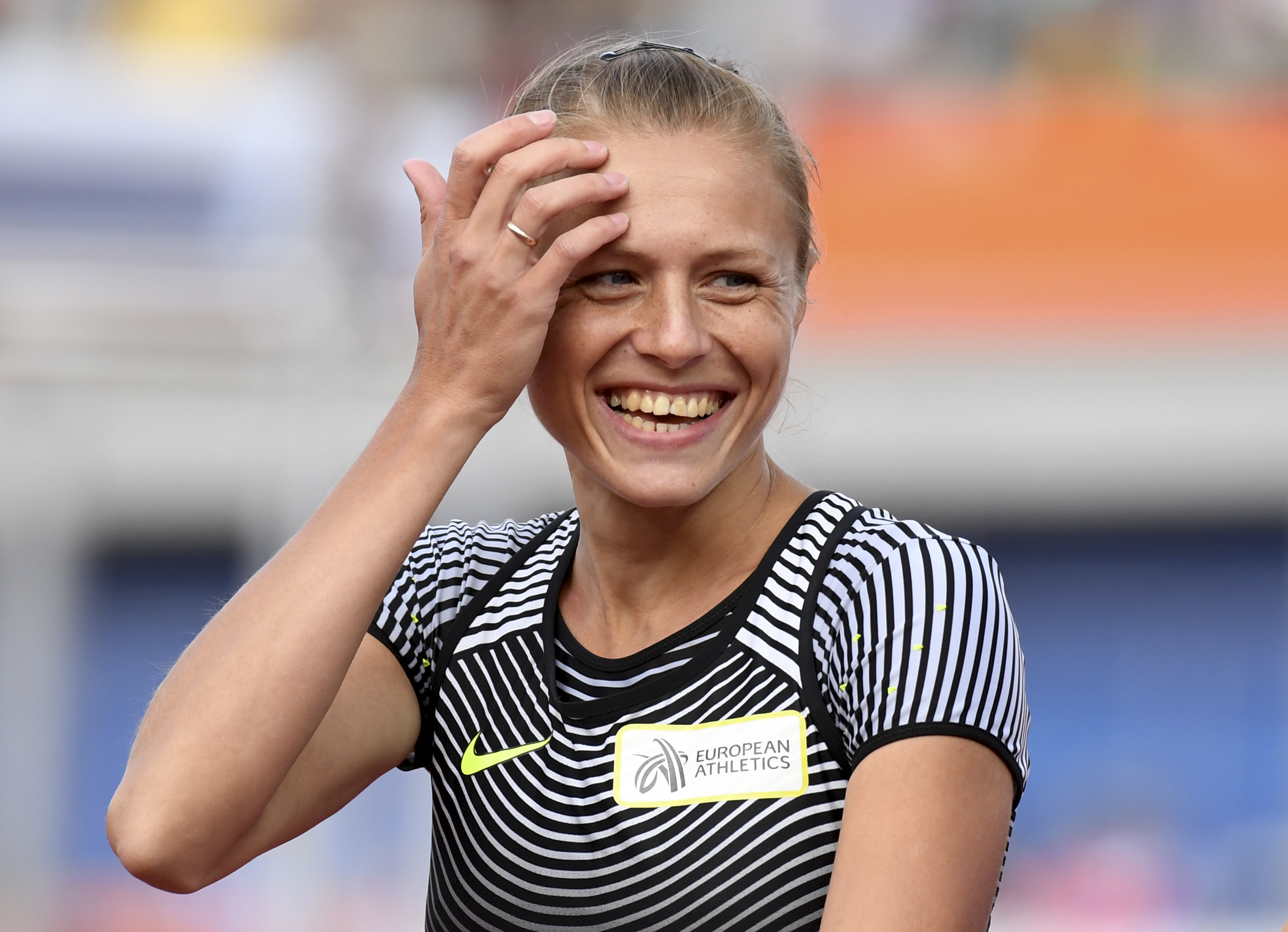 Russian doping whistleblower Yuliya Stepanova who runs under a neutral flag smiles before competing in a women's 800m heat during the European Athletics Championships in Amsterdam, the Netherlands, Wednesday, July 6, 2016. (AP Photo/Geert Vanden Wijngaert