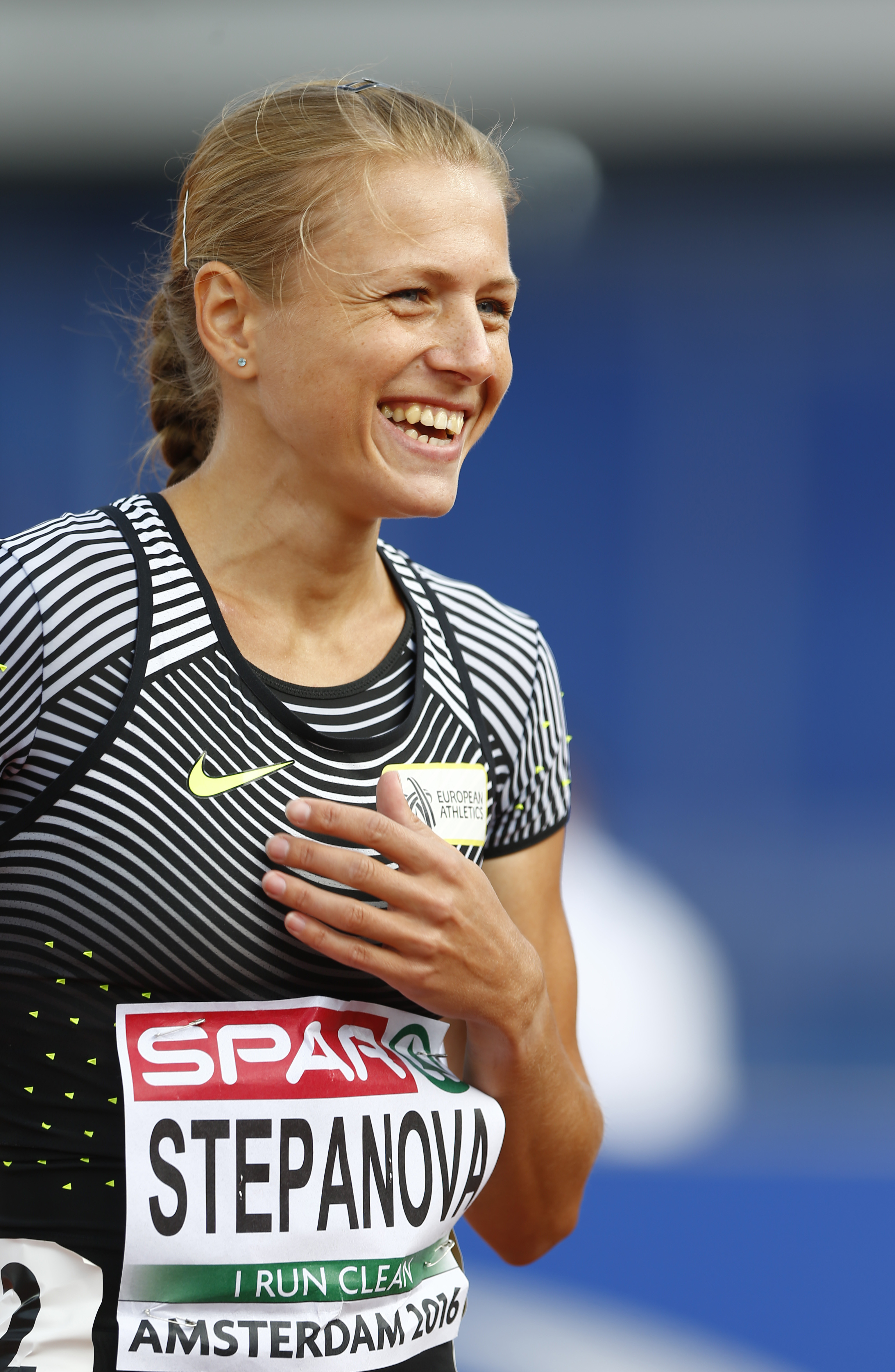 Russian doping whistleblower Yuliya Stepanova who runs under a neutral flag smiles before competing in a women's 800m heat during the European Athletics Championships in Amsterdam, the Netherlands, Wednesday, July 6, 2016. (AP Photo/Matthias Schrader)
