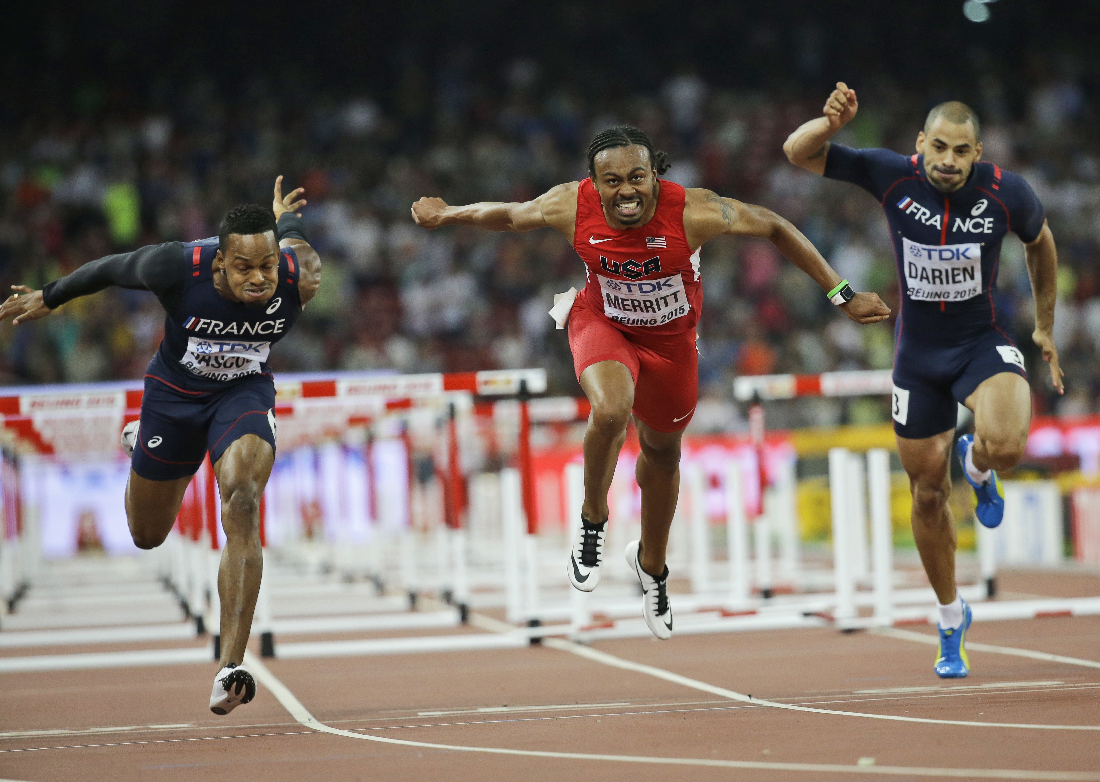FILE - In this Aug. 28, 2015, file photo, United States' Aries Merritt, center, France's Dimitri Bascou, left, and France's Garfield Darien compete in the men's 110m hurdles final at the World Athletics Championships at the Bird's Nest stadium in Beijing.