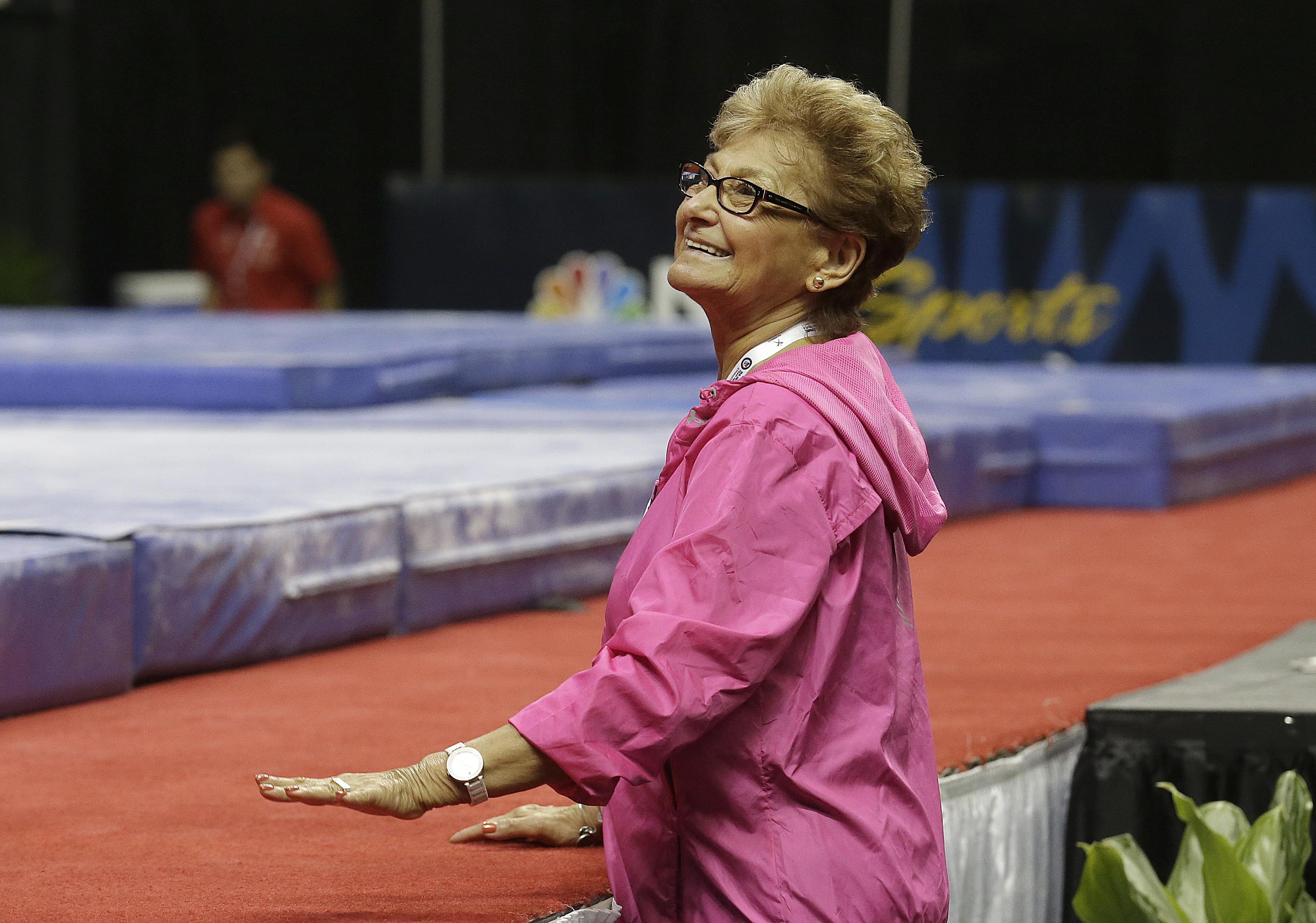 Marta Karolyi, national team coordinator for USA Gymnastics, smiles during practice at the U.S. Olympic trials in gymnastics in San Jose, Calif., Thursday, July 7, 2016. (AP Photo/Jeff Chiu)