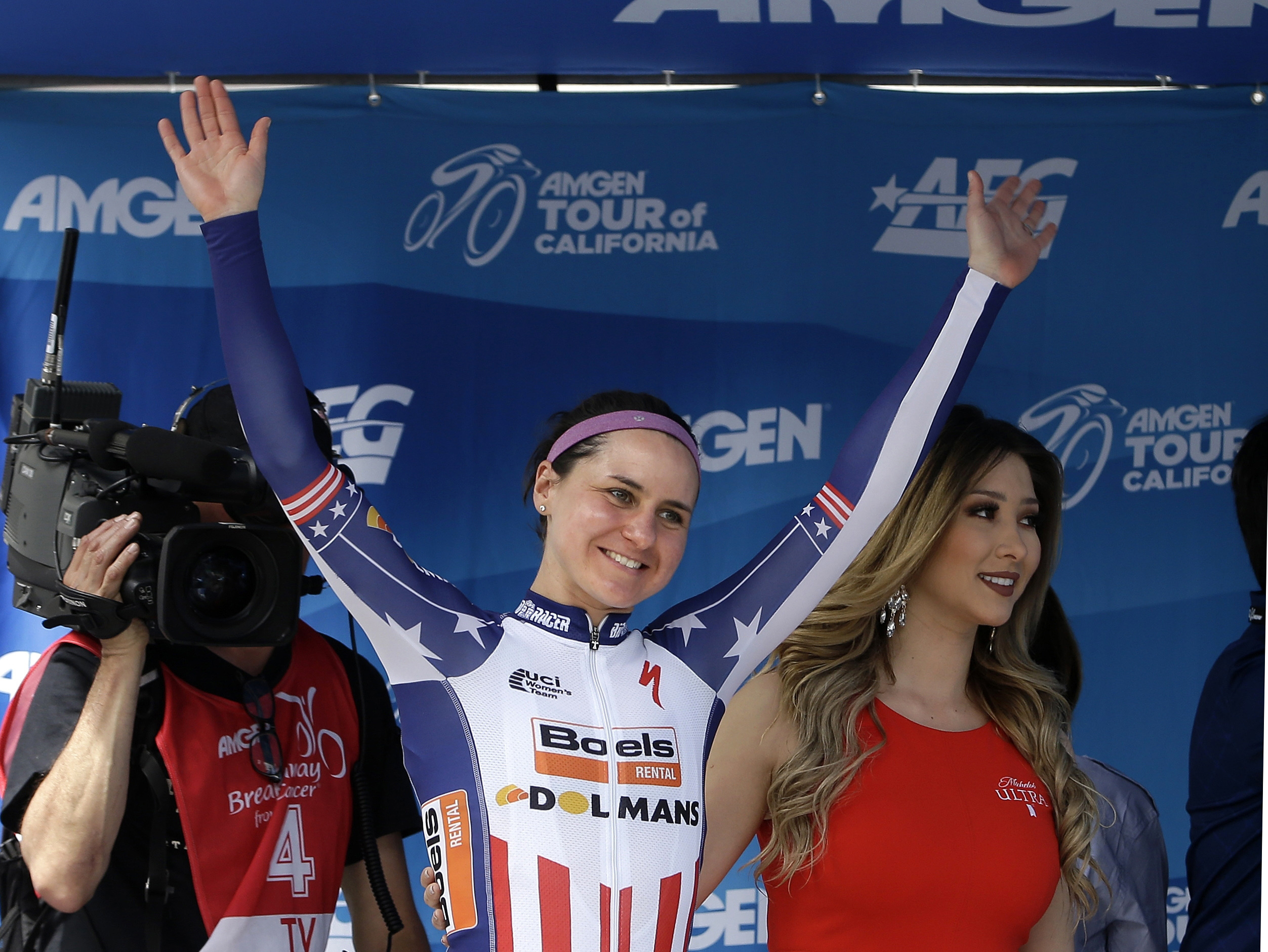 FILE - In this May 22, 2016, file photo, Megan Guarnier, of the United States, waves to the crowd after winning the women's Tour of California cycling race in Sacramento, Calif. The American women will arrive at the Rio Games as heavy favorites. Megan Gua