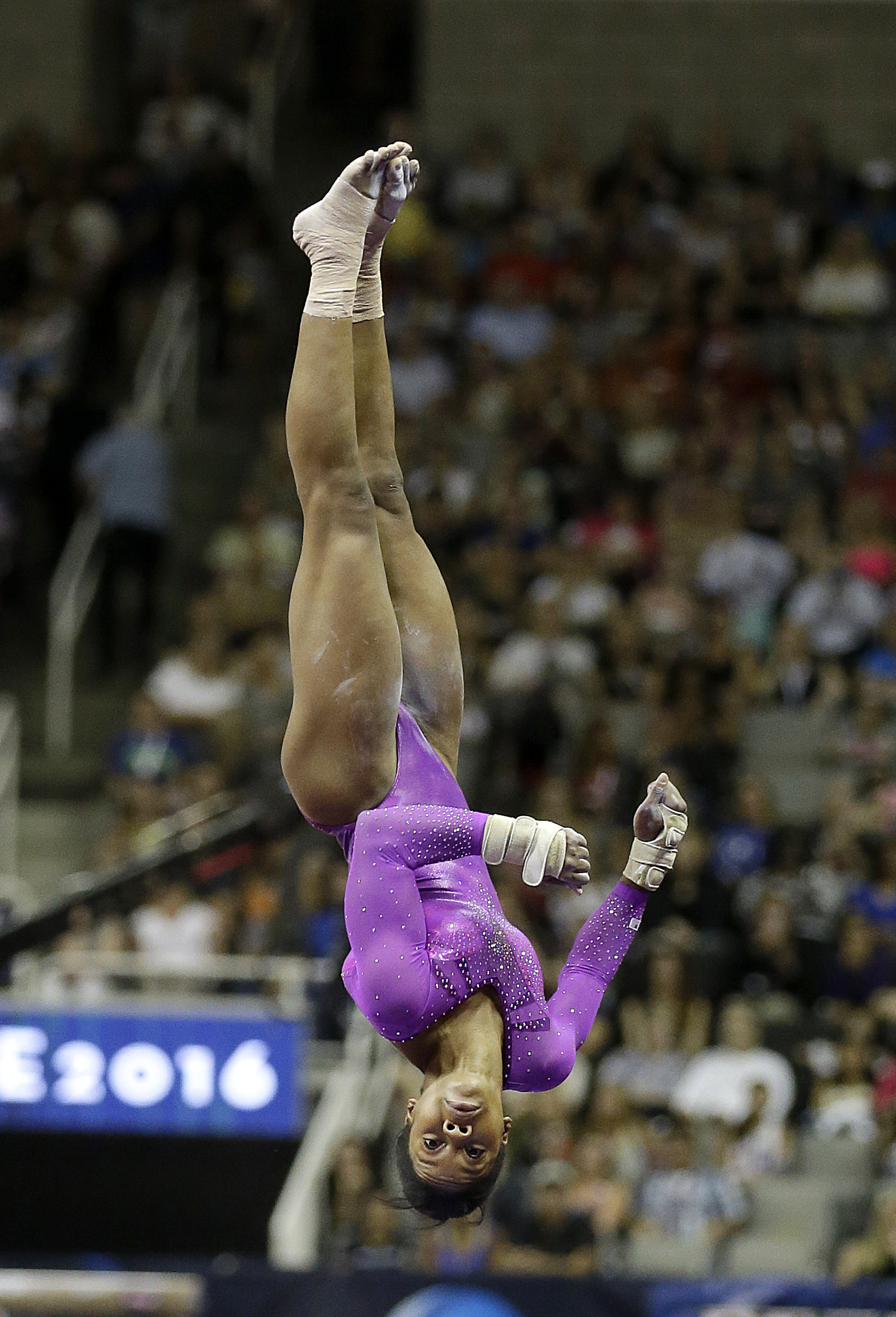 Gabrielle Douglas competes on the vault during the women's U.S. Olympic gymnastics trials in San Jose, Calif., Friday, July 8, 2016. (AP Photo/Ben Margot)
