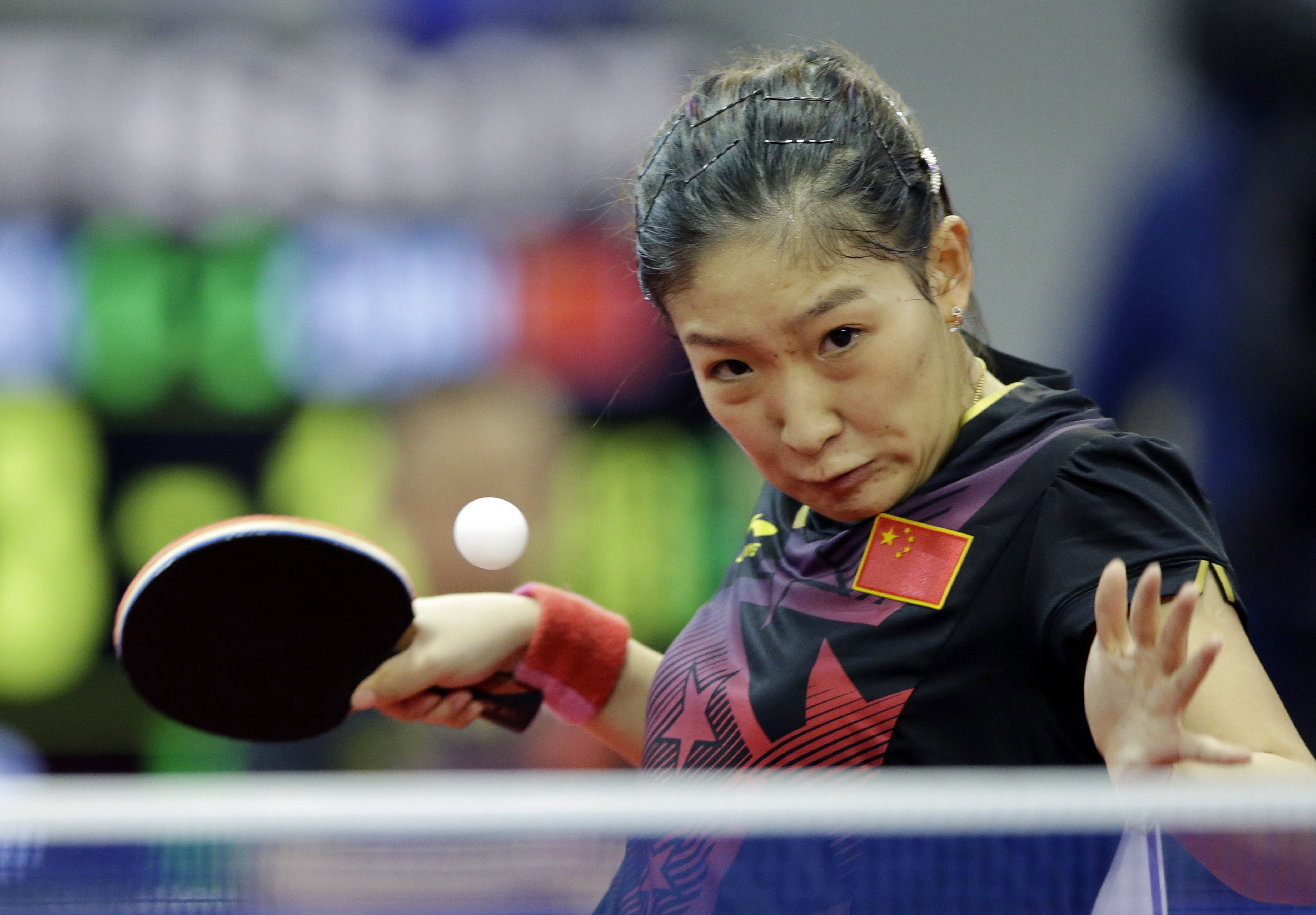 FILE - In this Oct. 2, 2014, file photo, China's Liu Shiwen returns a ball against North Korea's Ri Mi Gyong during the women's single table tennis match at the 17th Incheon Asian Games in Suwon, South Korea. Chinas overwhelming domination of table tennis