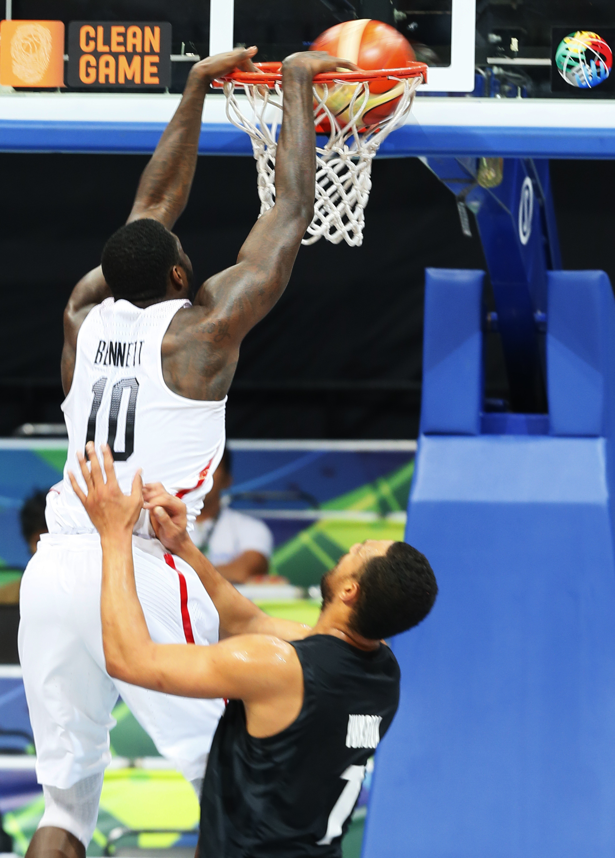 Canada's Anthony Bennet (10) slams to score during their semi-final match against New Zealand in the FIBA Olympic Qualifying basketball semi-final match Saturday, July 9, 2016 in suburban Pasay city south of Manila, Philippines. At right is New Zeraland's