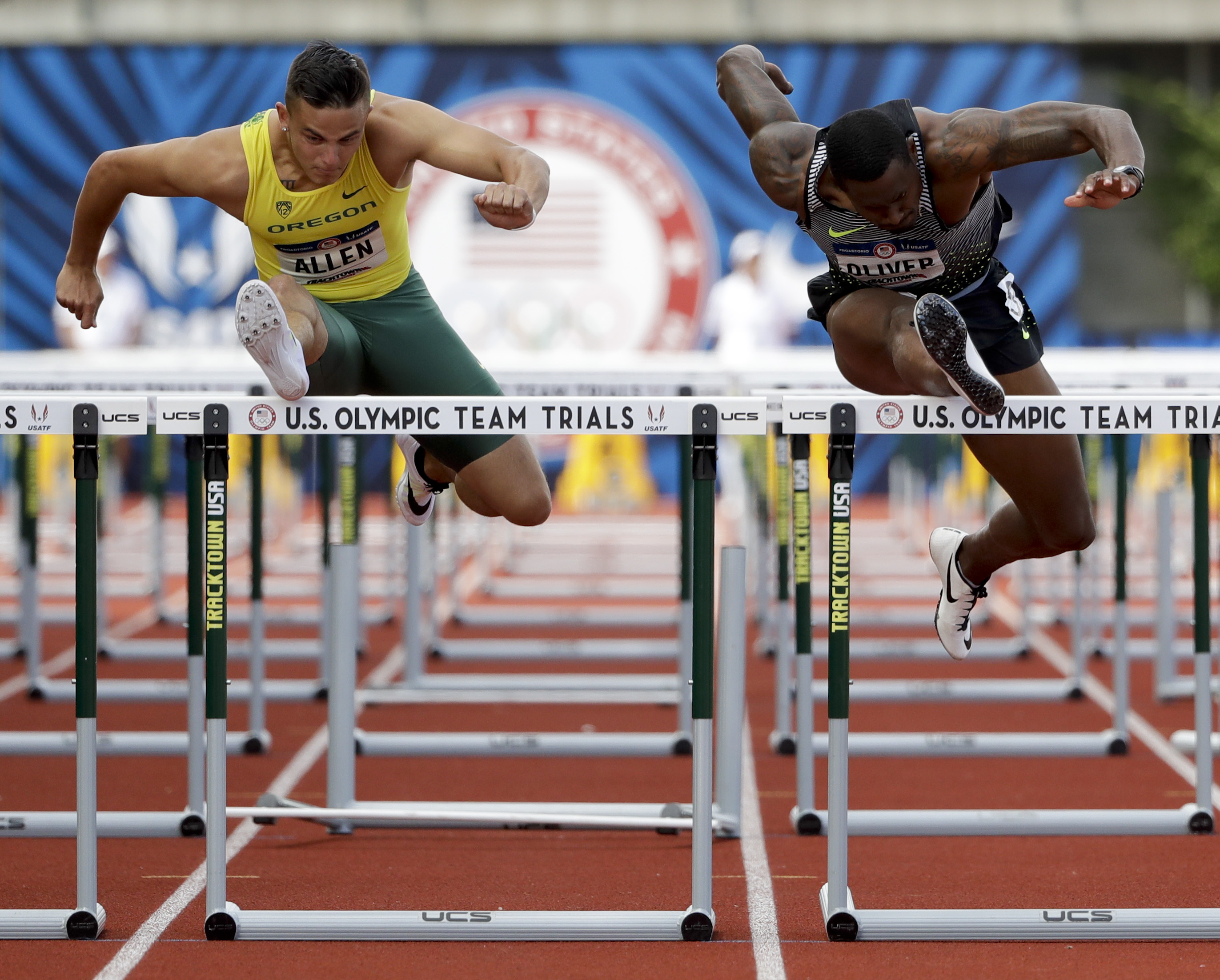 Devon Allen, left, beats David Oliver in the third heat of the semifinals in the men's 110-meter hurdles at the U.S. Olympic Track and Field Trials, Saturday, July 9, 2016, in Eugene Ore. (AP Photo/Marcio Jose Sanchez)
