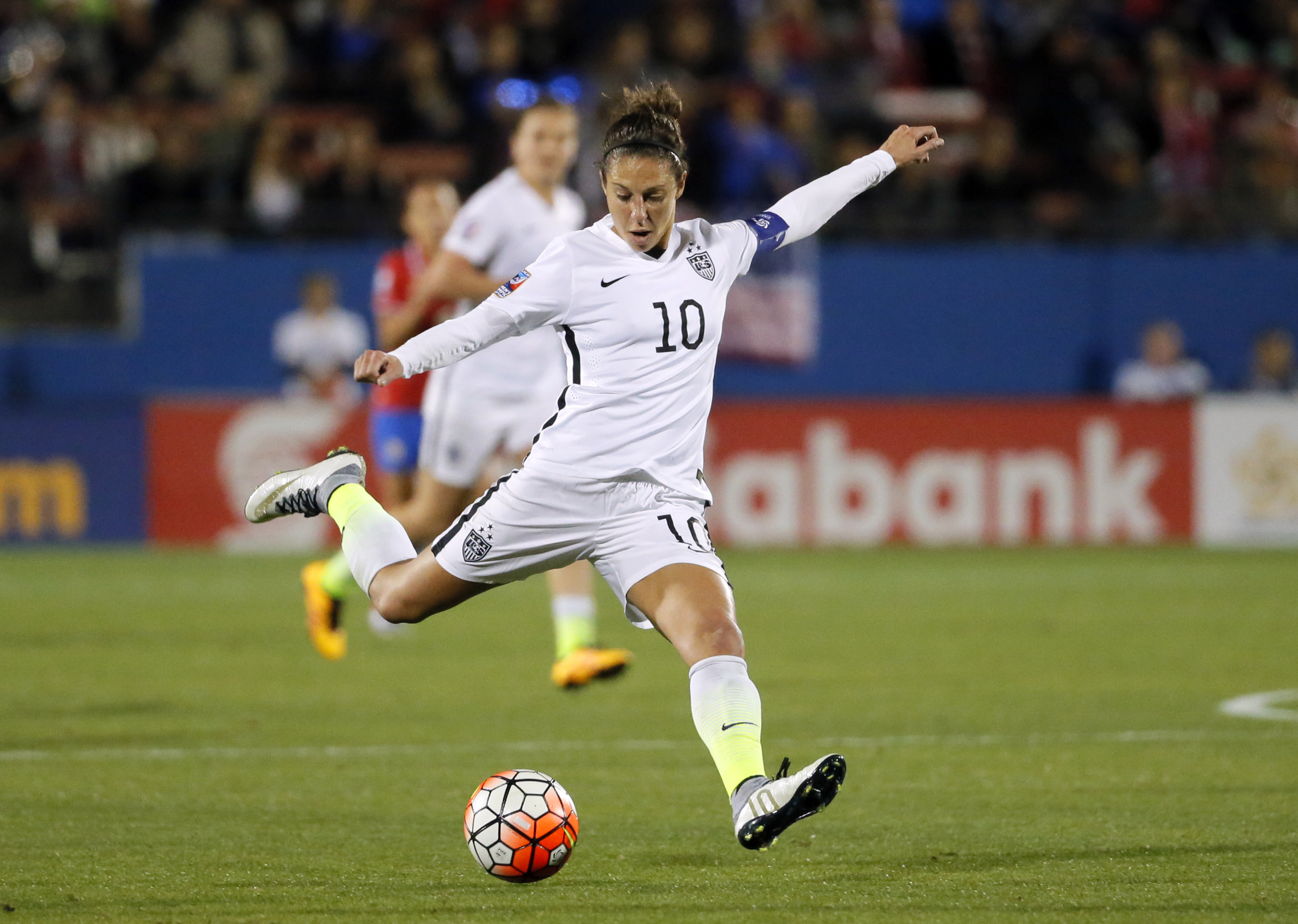 FILE - In this Feb. 10, 2016, file photo, United States' Carli Lloyd takes a shot at the Costa Rica goal during a CONCACAF Olympic qualifying tournament soccer match in Frisco, Texas. After being cut from the Under-21 U.S. national team, Lloyd was having