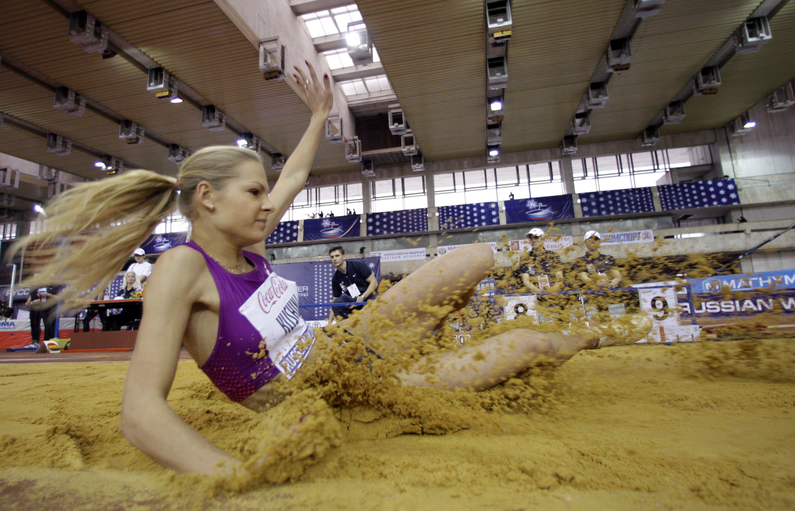 FILE - In this Sunday Feb. 6, 2011 file photo, Russia's Daria Klishina lands in the sand during a long jump event at the Russian Winter IAAF Indoor Athletic championship in Moscow. The IAAF said Sunday, July 10, 2016, that U.S.-based Russian long jumper D