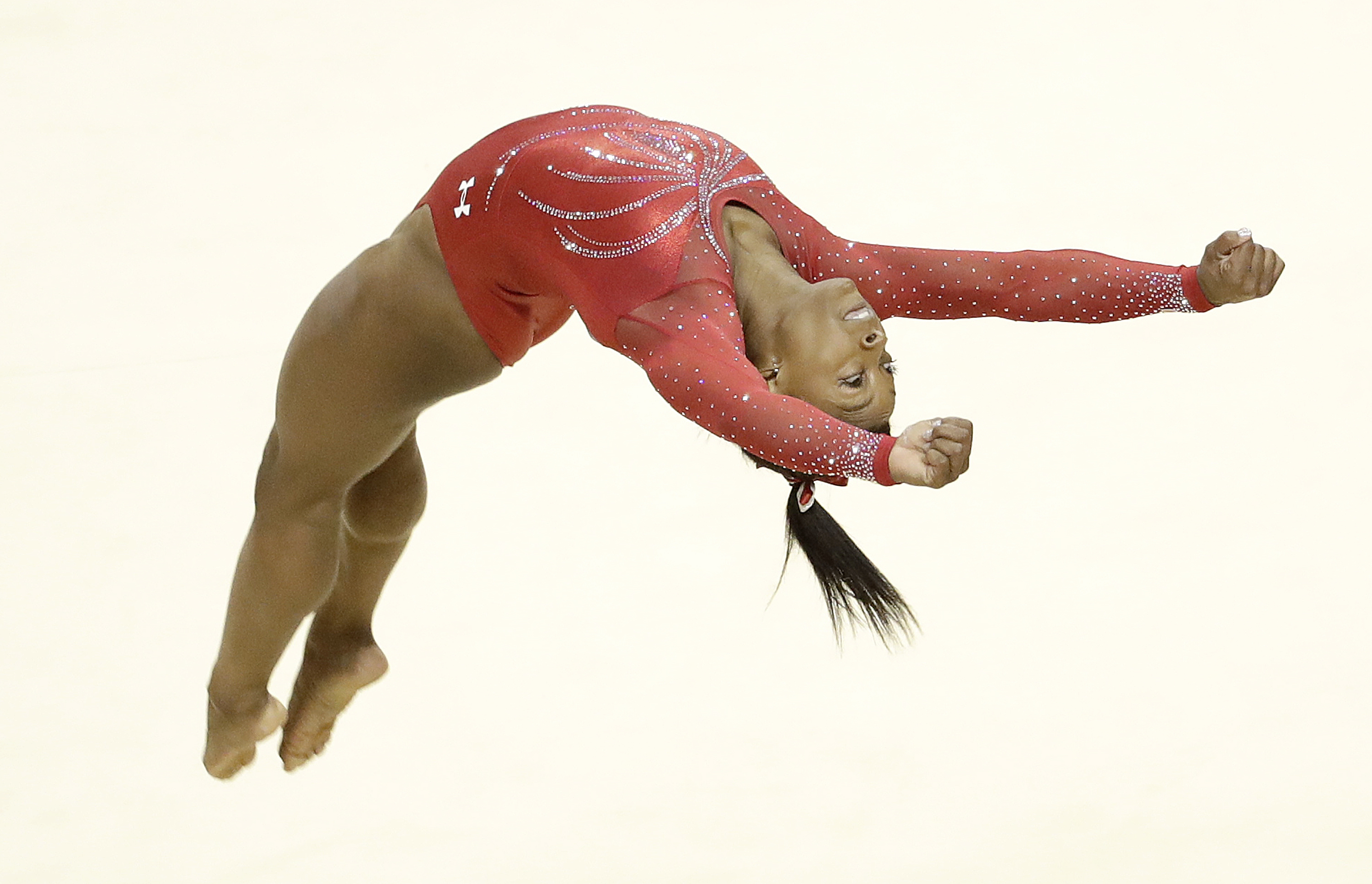 Simone Biles competes on the floor exercise during the women's U.S. Olympic gymnastics trials in San Jose, Calif., Sunday, July 10, 2016. (AP Photo/Gregory Bull)