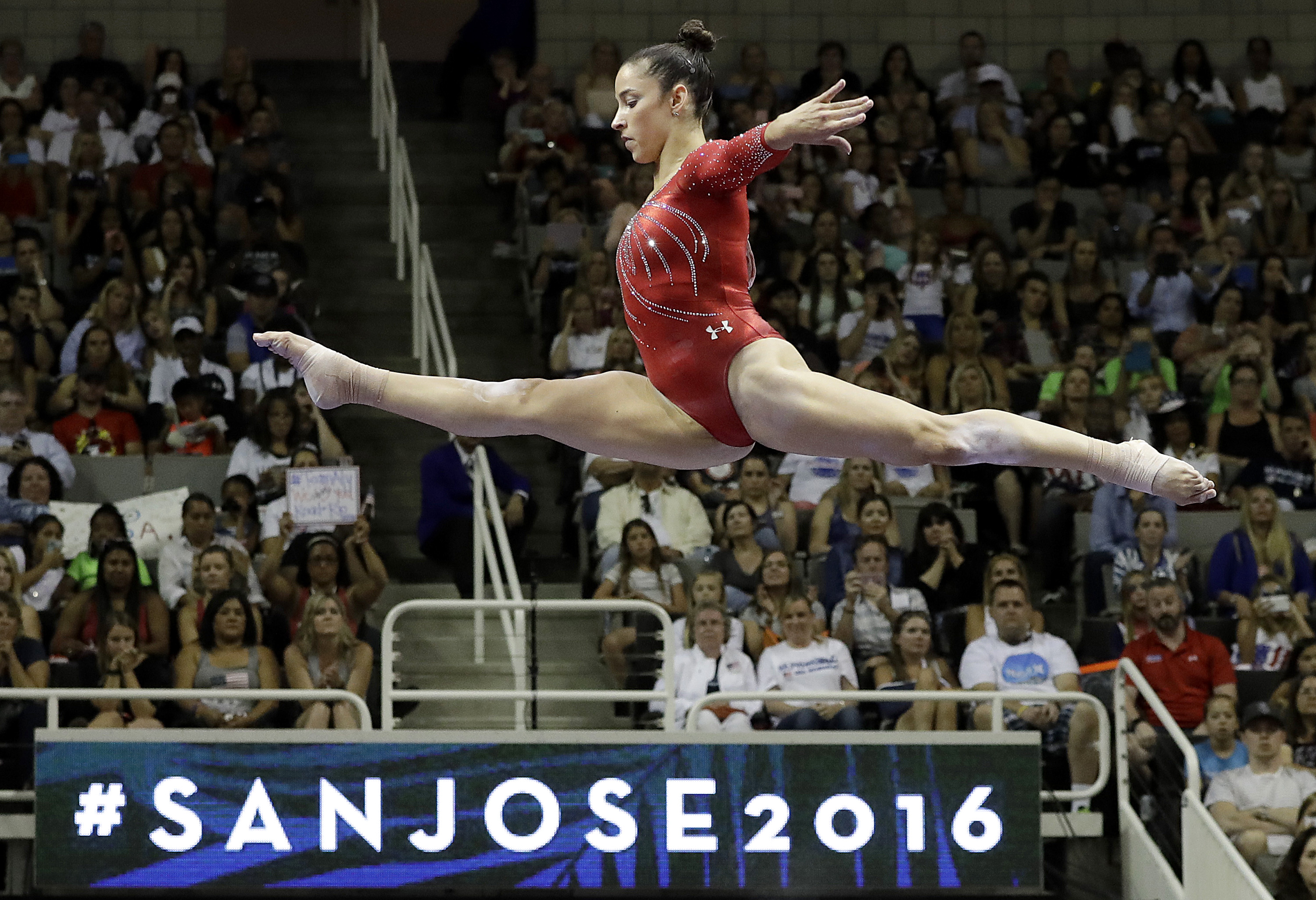 Aly Raisman competes on the balance beam during the women's U.S. Olympic gymnastics trials in San Jose, Calif., Sunday, July 10, 2016. (AP Photo/Gregory Bull)