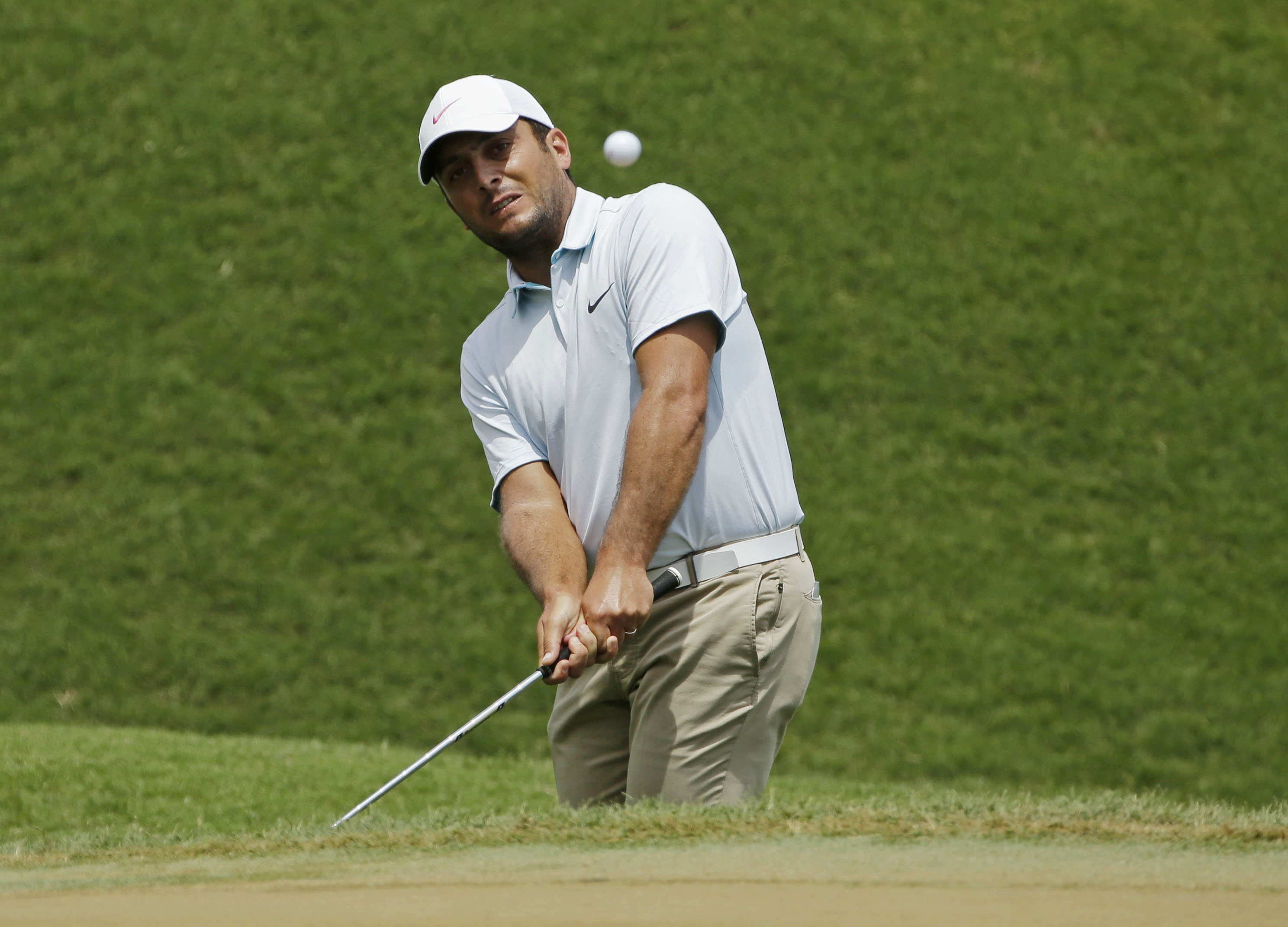 Francesco Molinari of Italy, hits onto the second green during the final round of The Players Championship golf tournament Sunday, May 15, 2016, in Ponte Vedra Beach, Fla. (AP Photo/Chris O'Meara)
