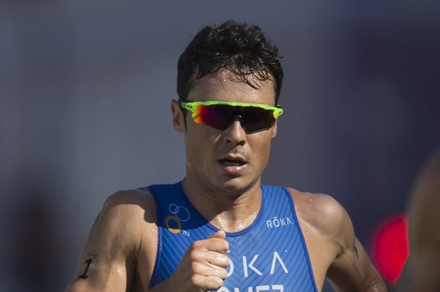 FILE  In this Aug. 2, 2015 file picture Javier Gomez Noya, of Spain, competes during the men's triathlon ITU World Olympic Qualification Event , in Rio de Janeiro, Brazil.  Spanish triathlete Javier Gomez has been awarded Spain's highest sports honor afte