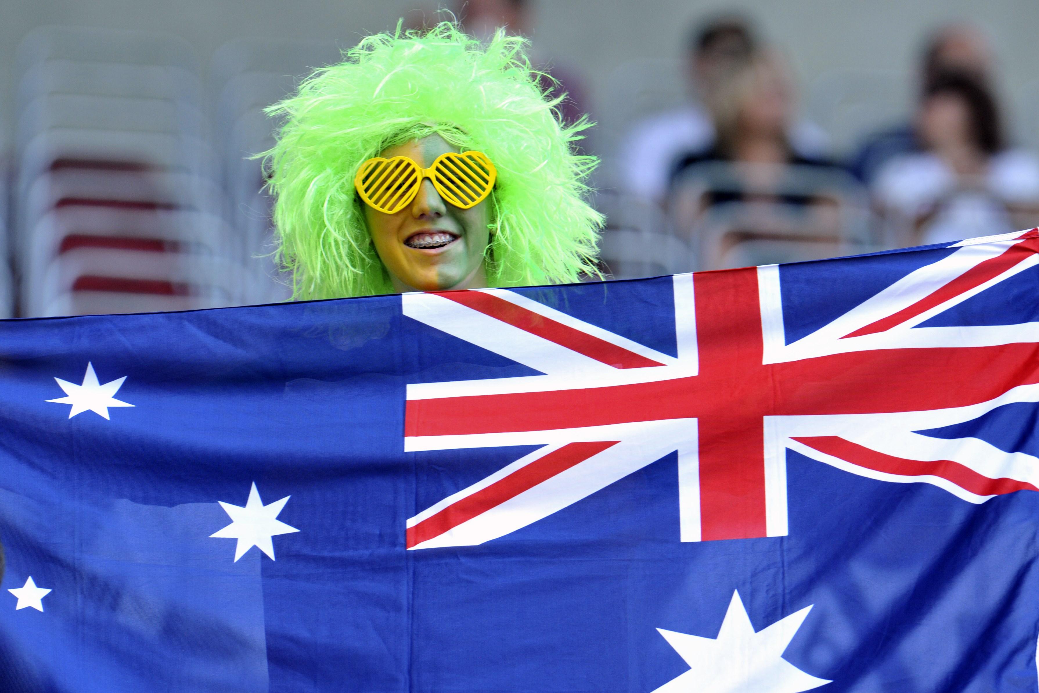 A soccer fan holds a flag on Australia before the quarterfinal match between Sweden and Australia at the Womens Soccer World Cup in Augsburg, southern Germany, on Sunday, July 10, 2011. (AP Photo/Kerstin Joensson)