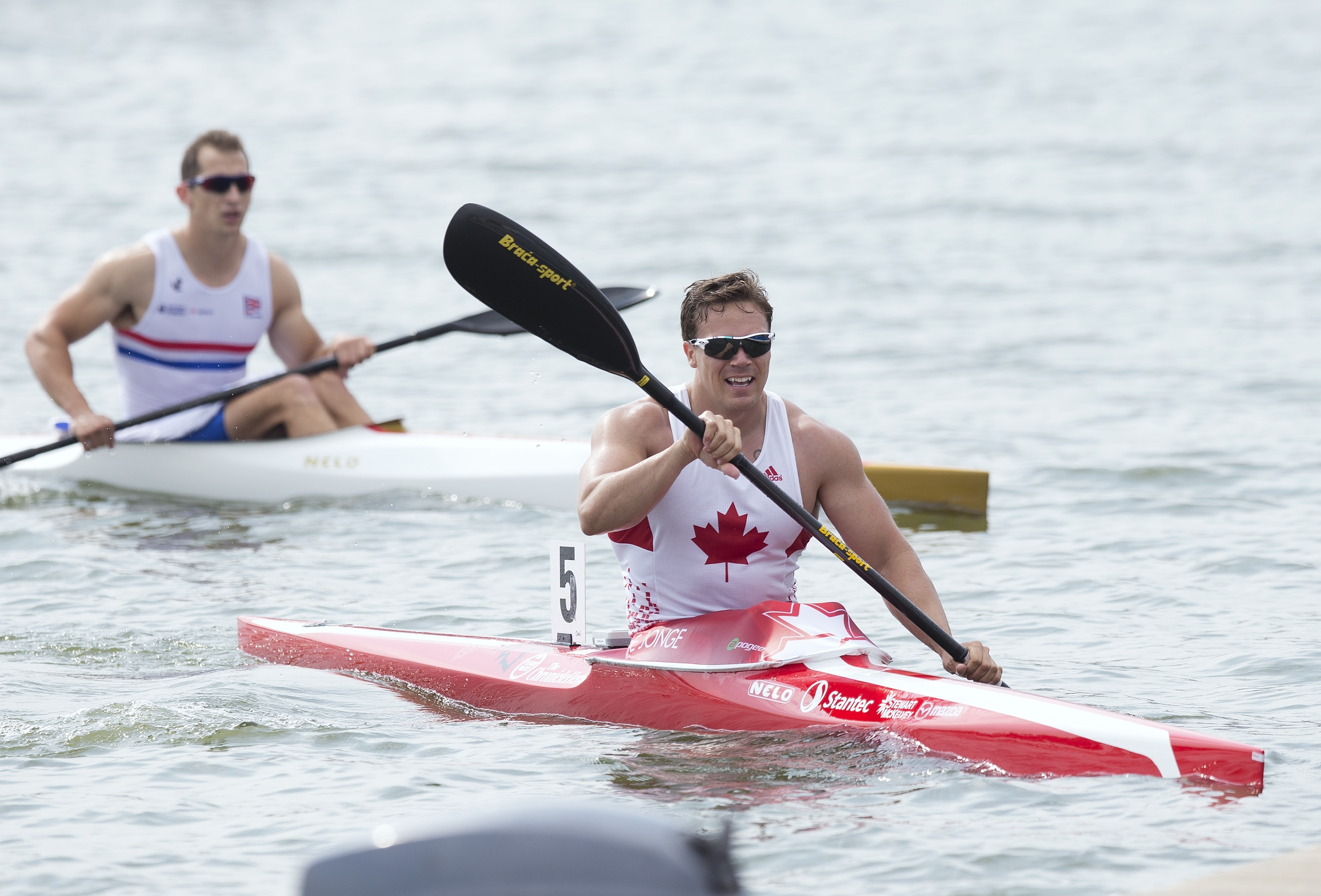 FILE - In this Aug. 10, 2014, file photo, Canada's Mark De Jonge, right, rides his canoe after winning at the K1 men 200m final of the ICF Canoe Sprint World Championships 2014 in Moscow, Russia. After winning bronze in London, the 32-year-old engineer he