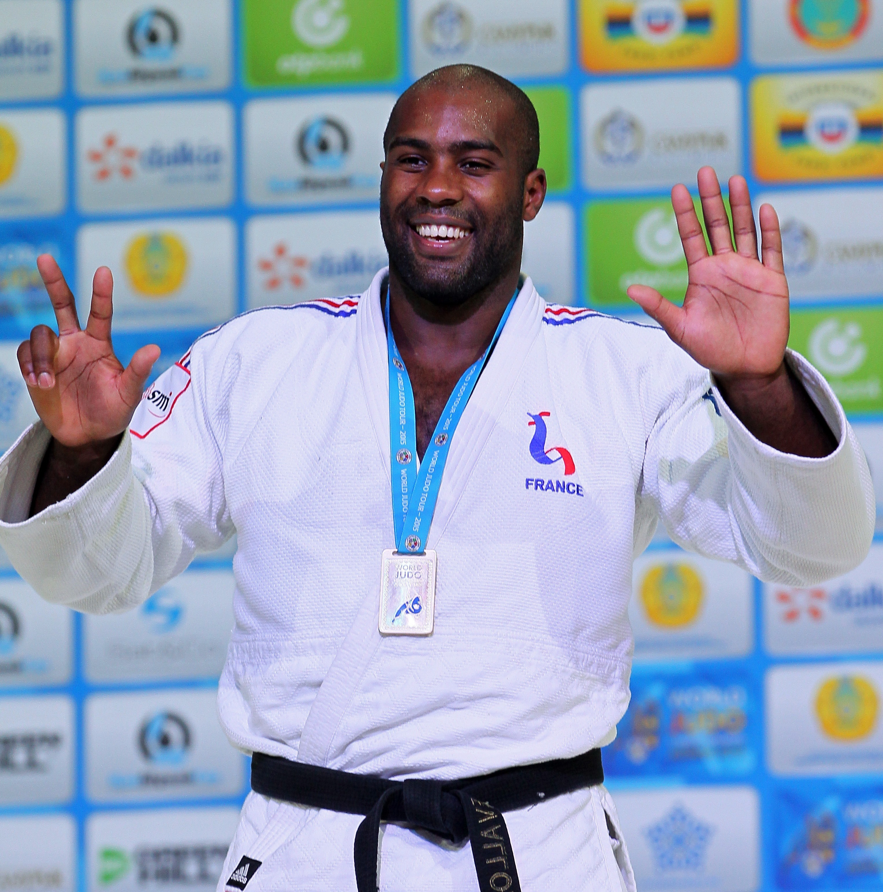 FILE - In this Aug. 29, 2015, file photo, France's Teddy Riner poses during an award ceremony of the men's +100 kg final at the World Judo Championships in Astana, Kazakhstan. The 27-year-old heavyweight has won a record eight world championship titles, f
