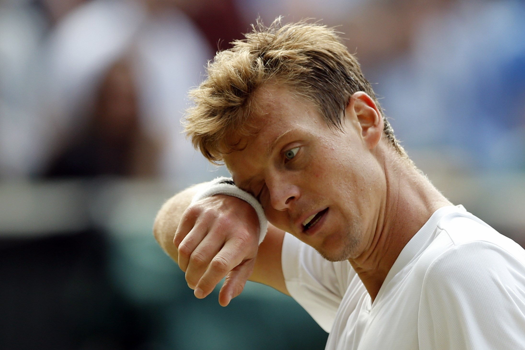 Tomas Berdych of the Czech Republic wipes his face during his men's semifinal singles match against Andy Murray of Britain during their men's semifinal singles match on day twelve of the Wimbledon Tennis Championships in London, Friday, July 8, 2016. (AP